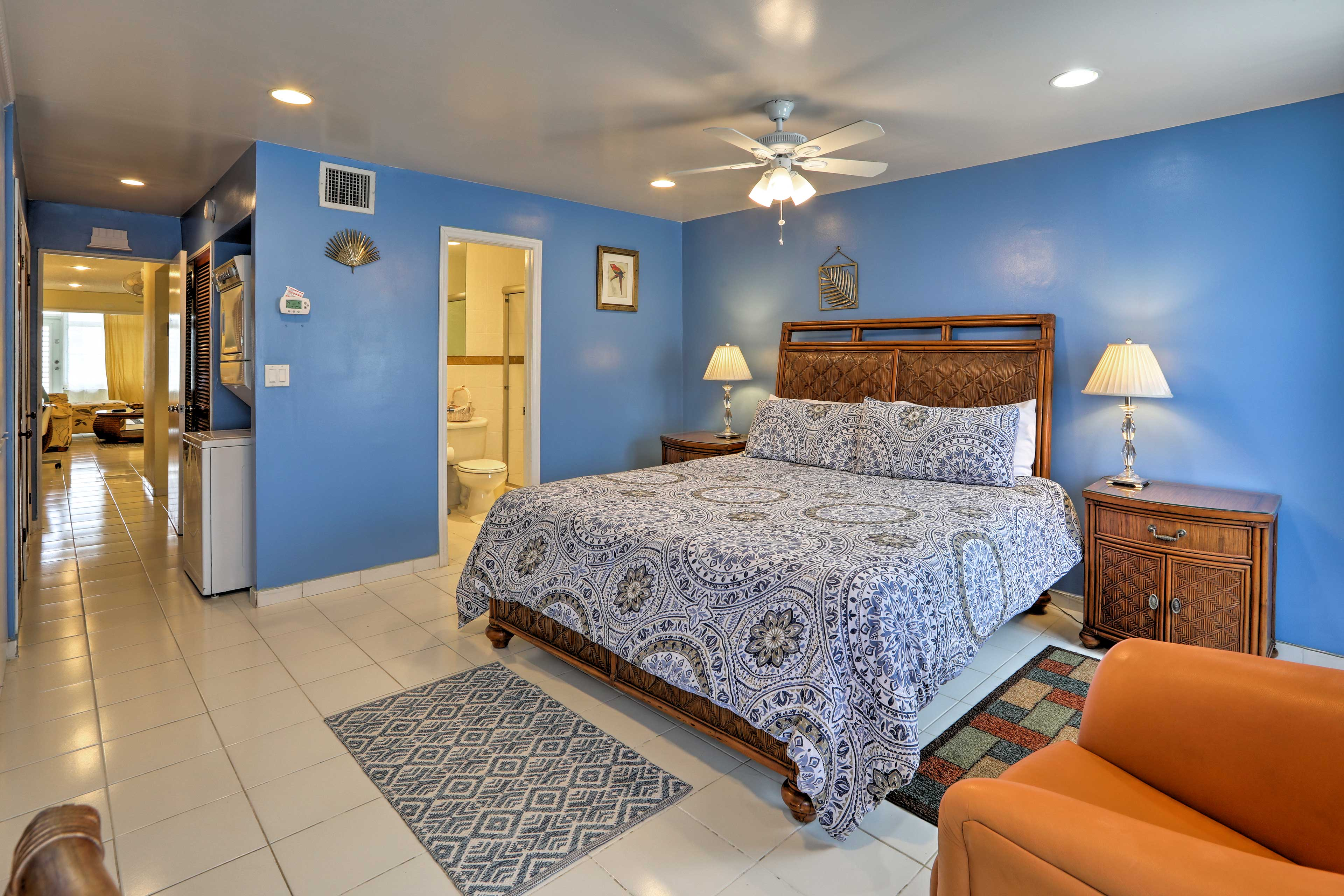The king master suite boasts the perfect pop of color.