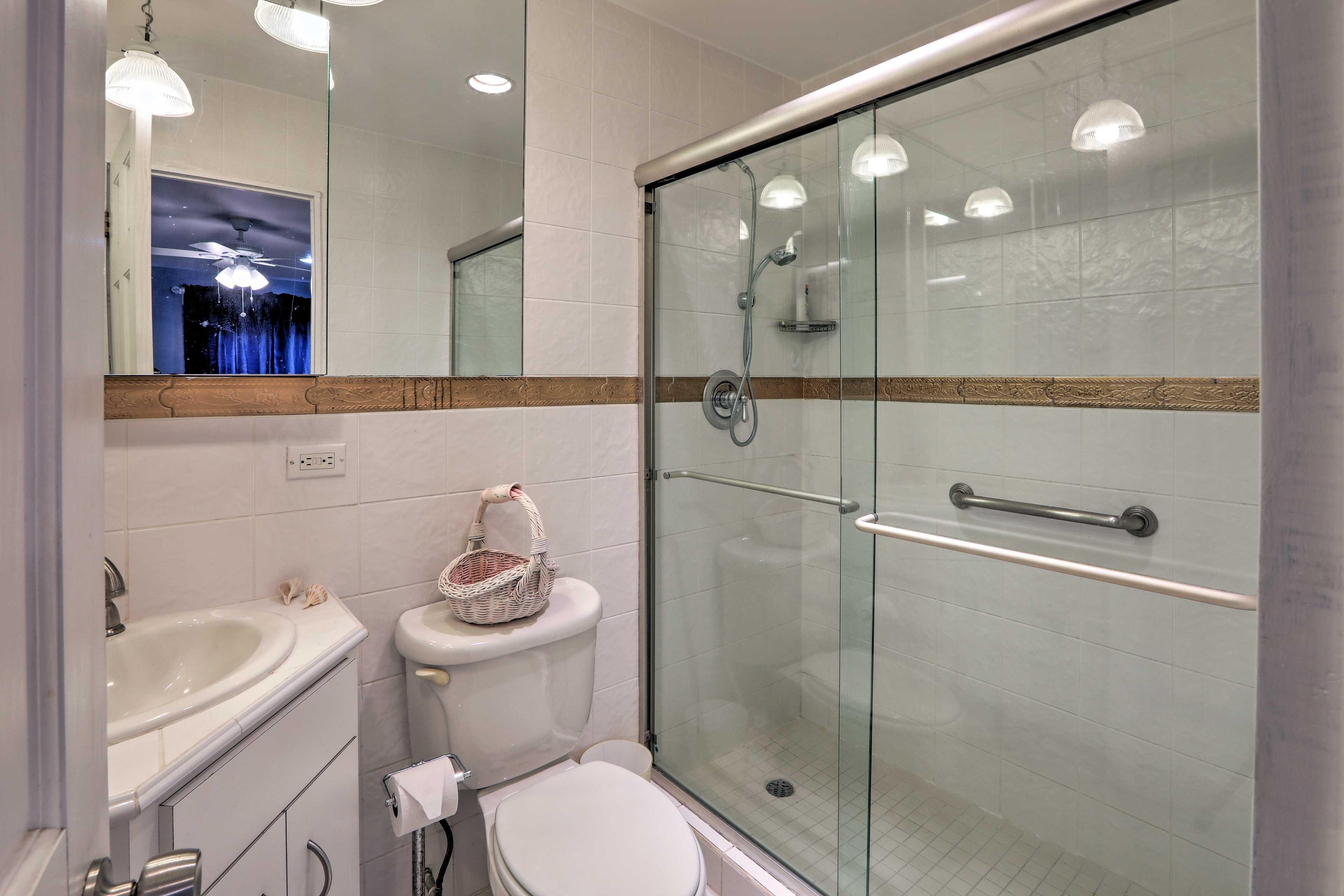 Rinse off in the walk-in shower in the en-suite bathroom.