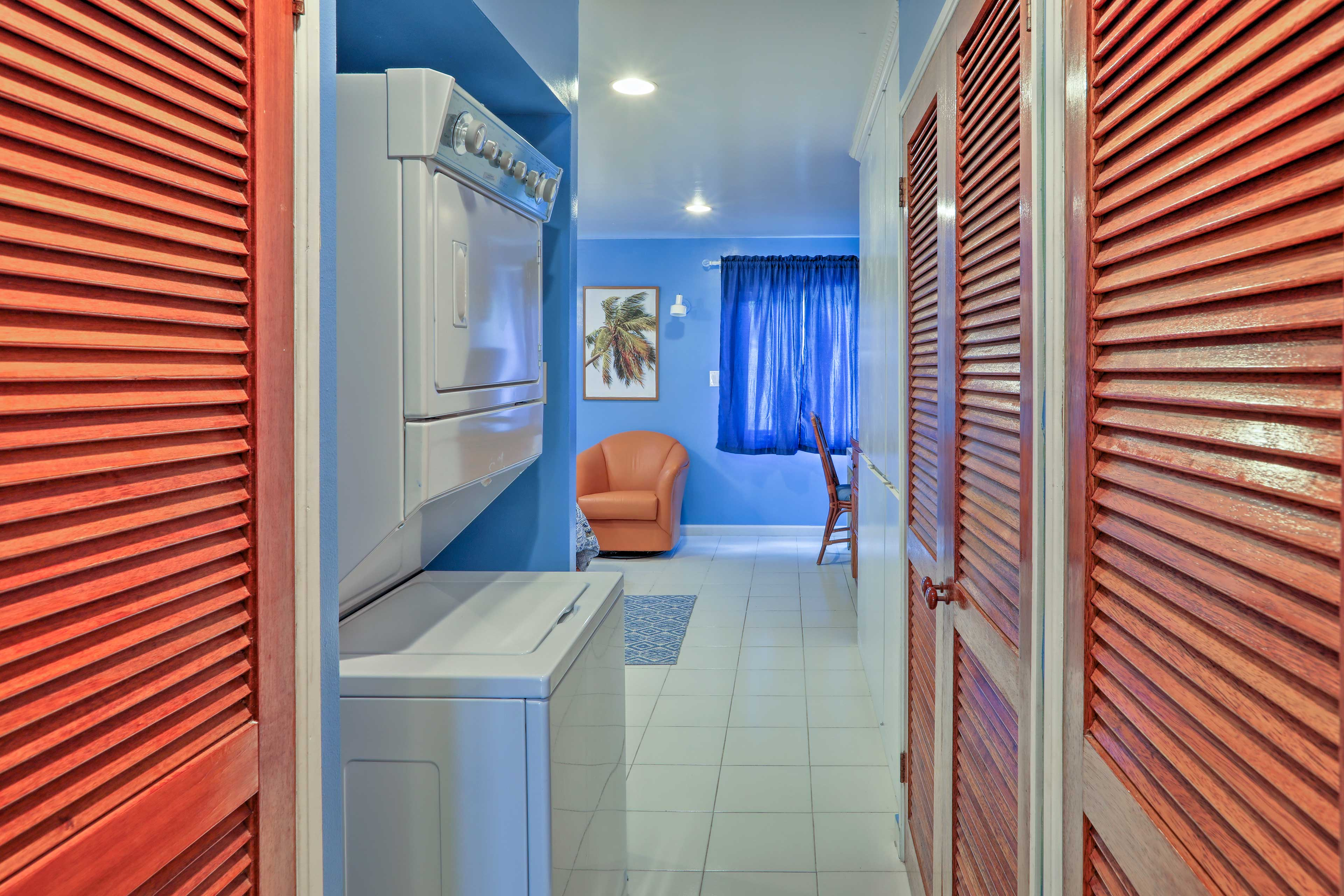 Stacked laundry machines are provided for your convenience.