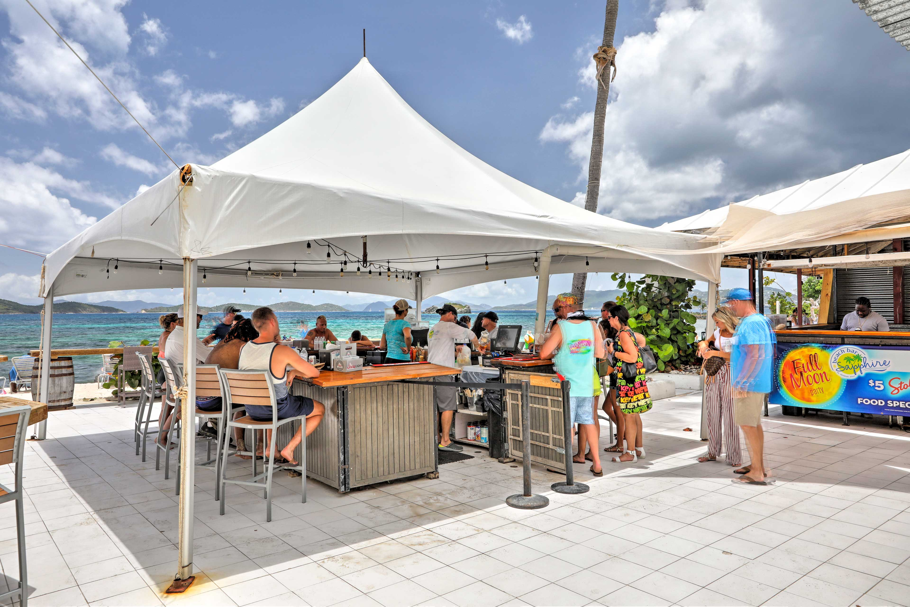 Meet other travelers at the popular beachfront tiki bar!