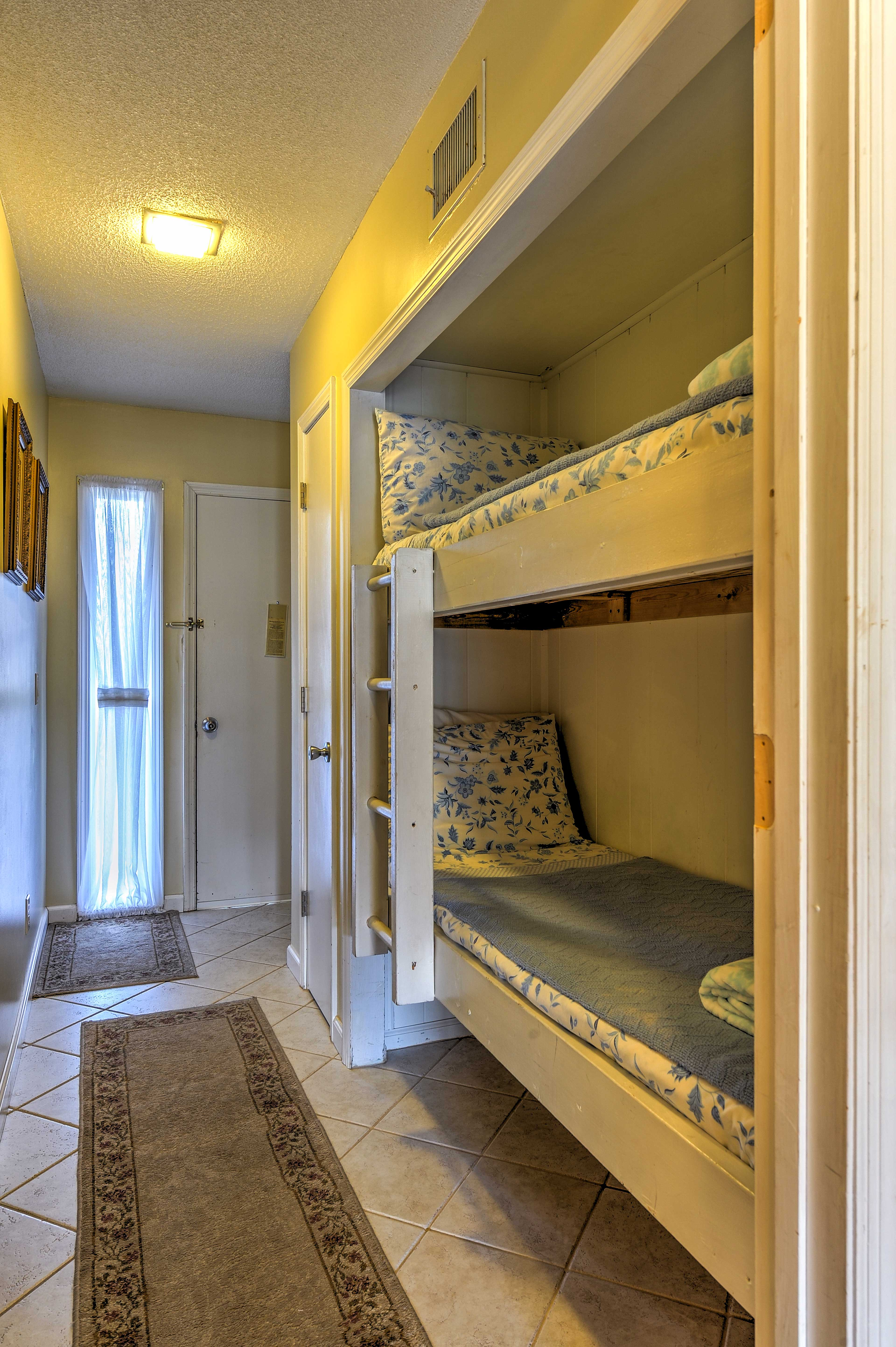 The kids will love the twin-over-twin bunk bed in the hallway.
