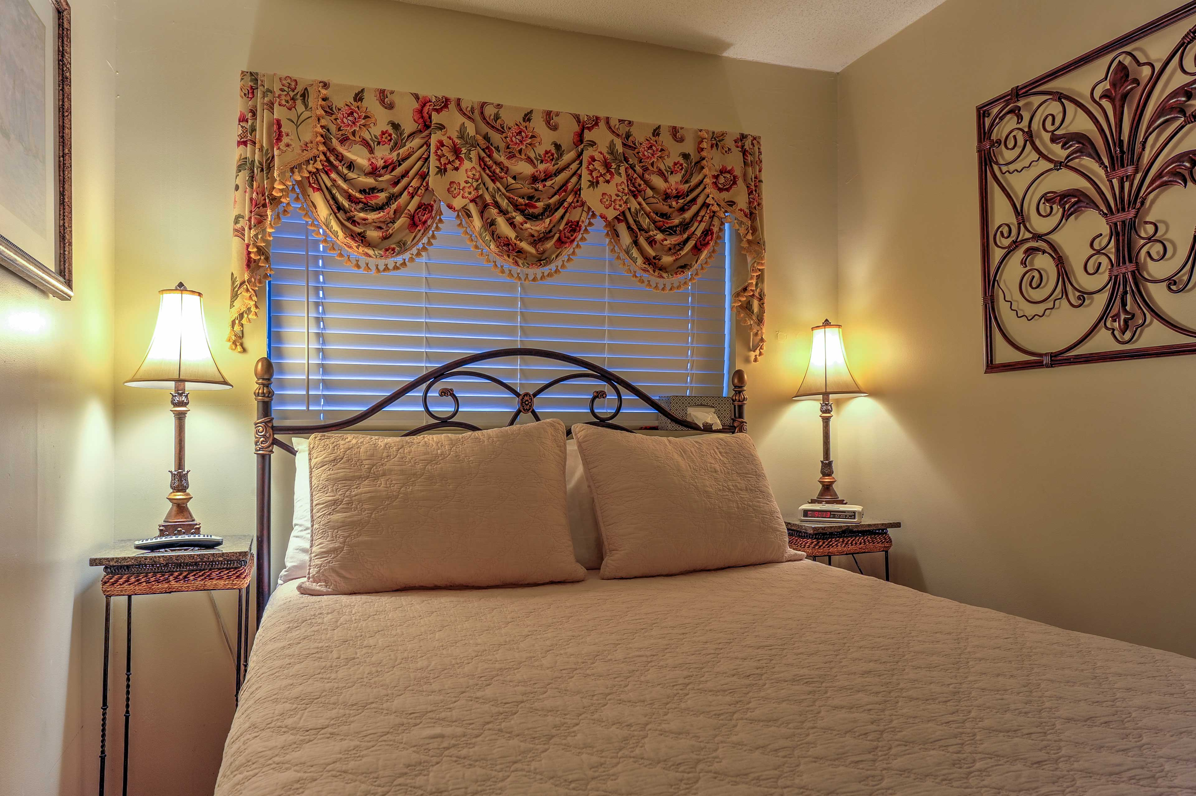 Cuddle up for the night in the bedroom's queen-sized bed.