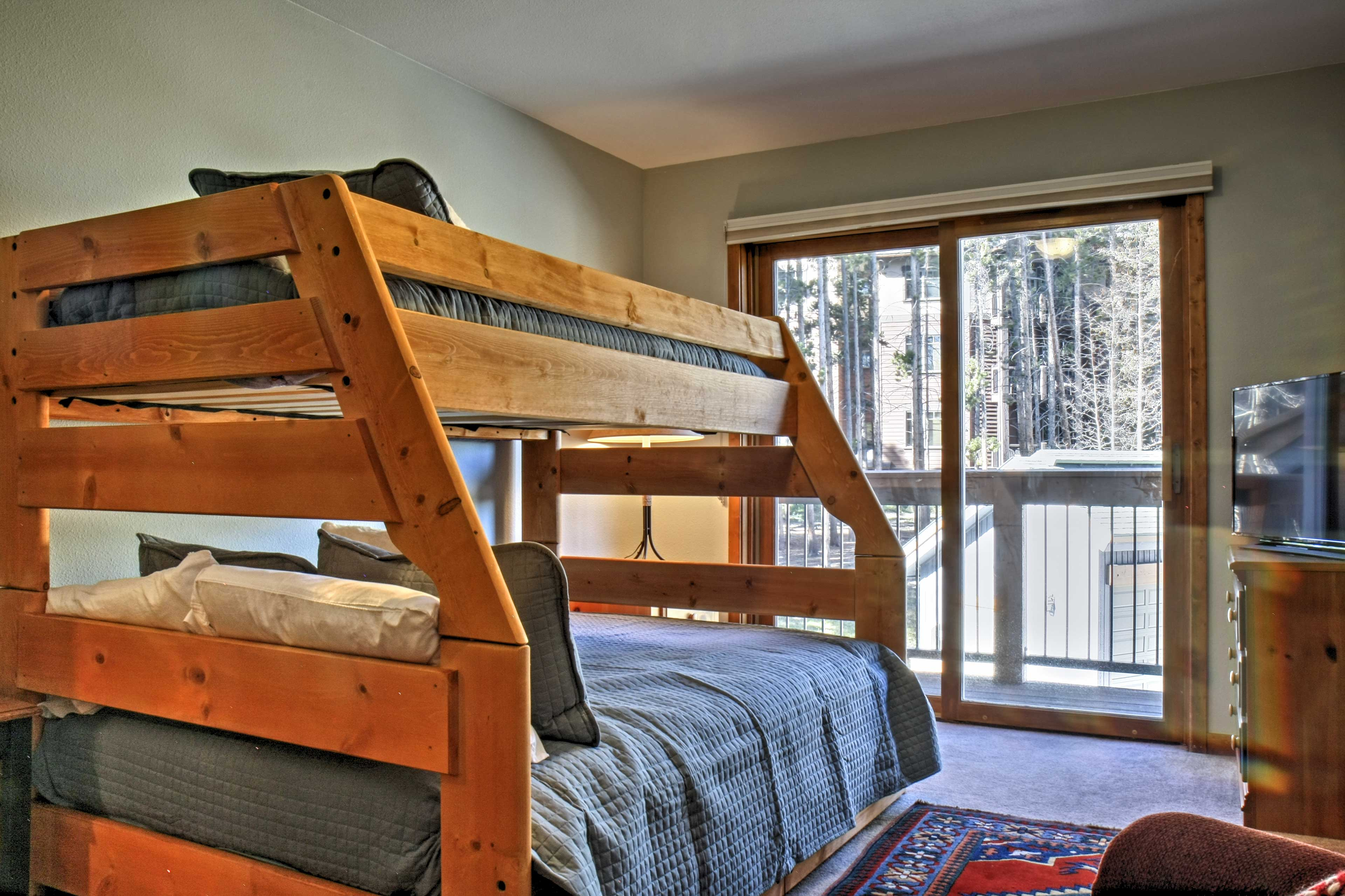 Bedroom 3 boasts earthy decor and a private balcony with mountain views.