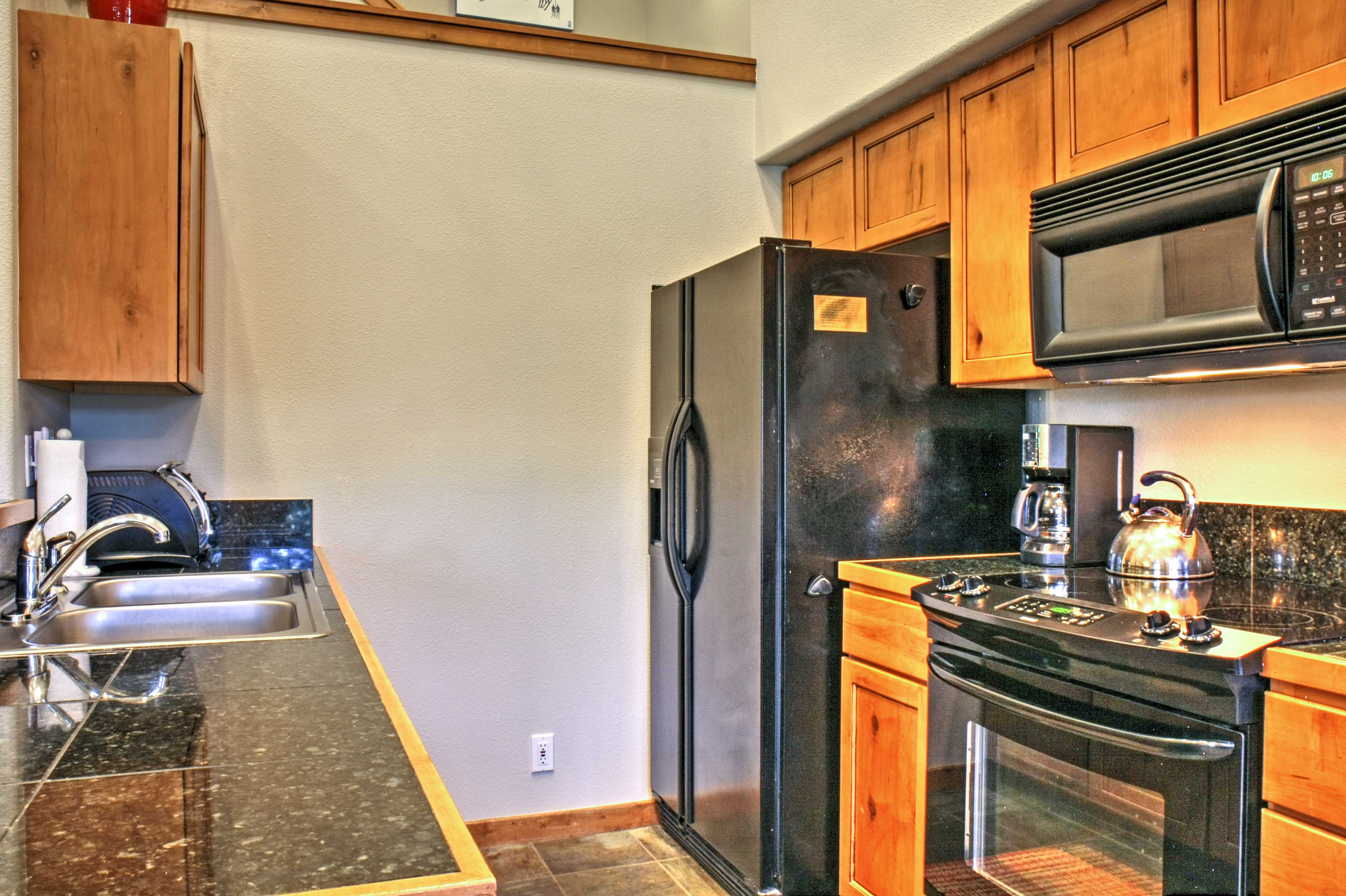 Whip up home-cooked meals for friends in this sleek, fully equipped kitchen.