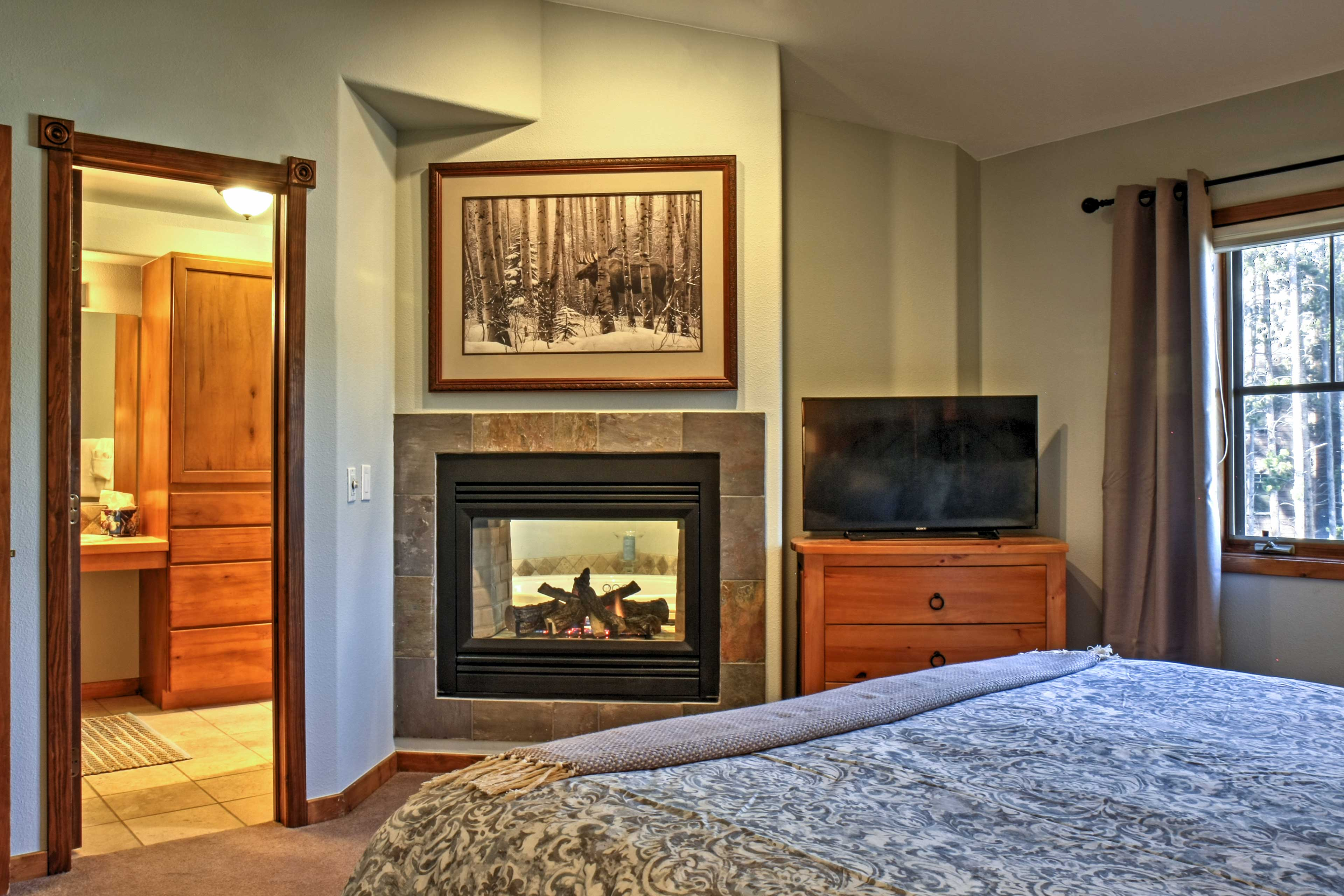 Turn on the flat-screen cable TV while the gas fireplace warms the room.