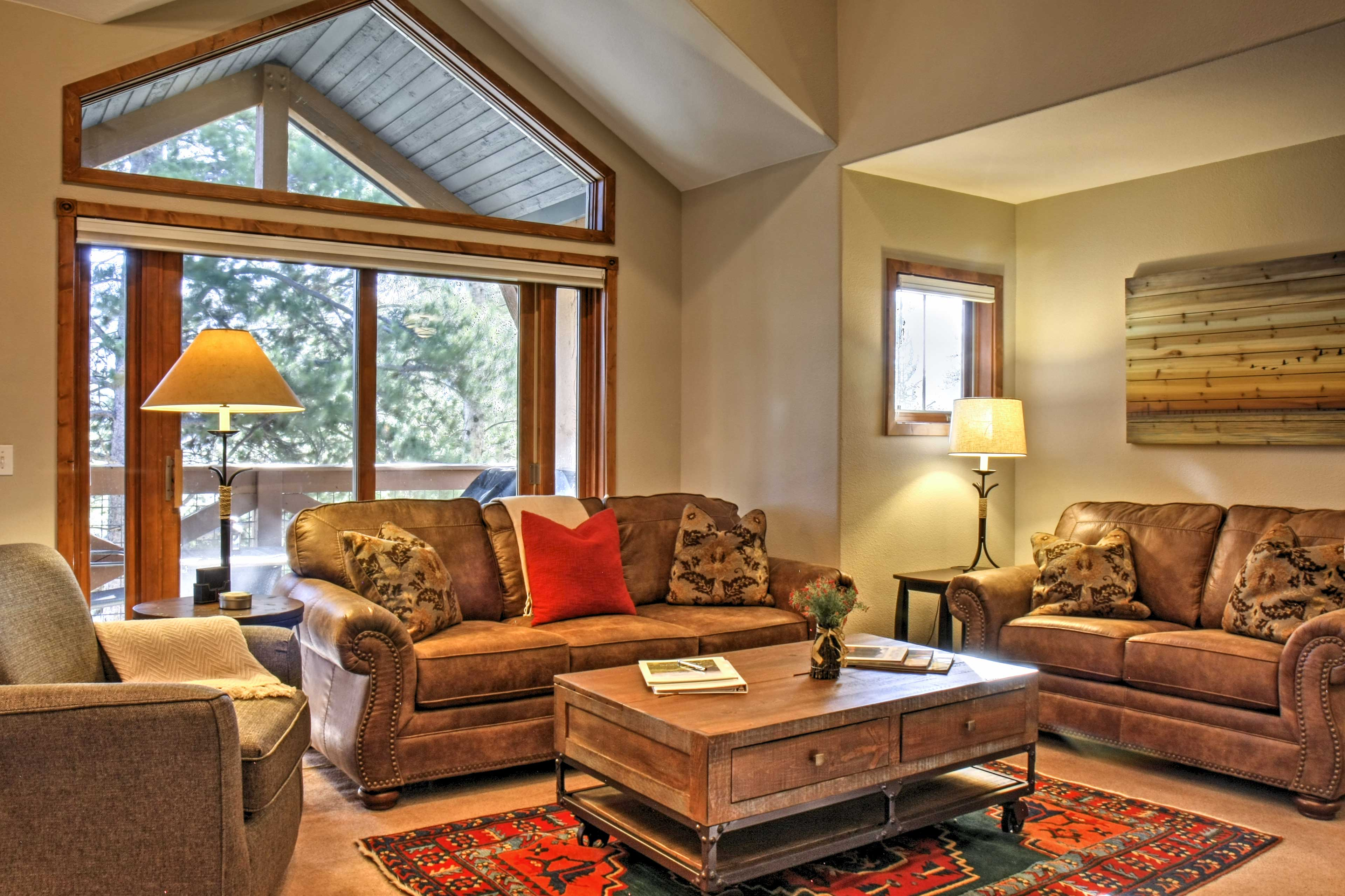 Make yourself at home in this warm living area boasting a Smart TV & fireplace!