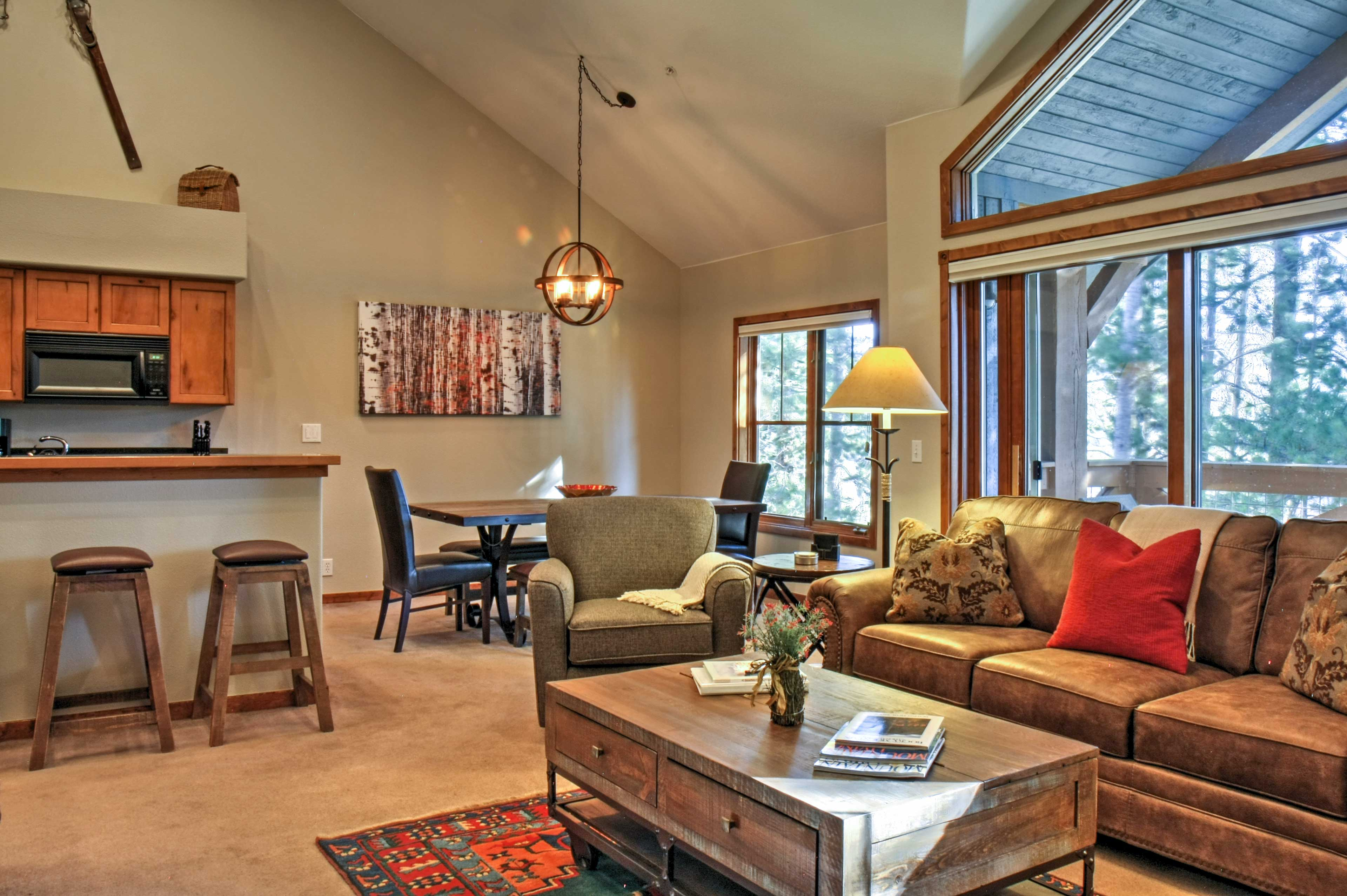 The large windows allow natural light to pour in, fostering a bright atmosphere.