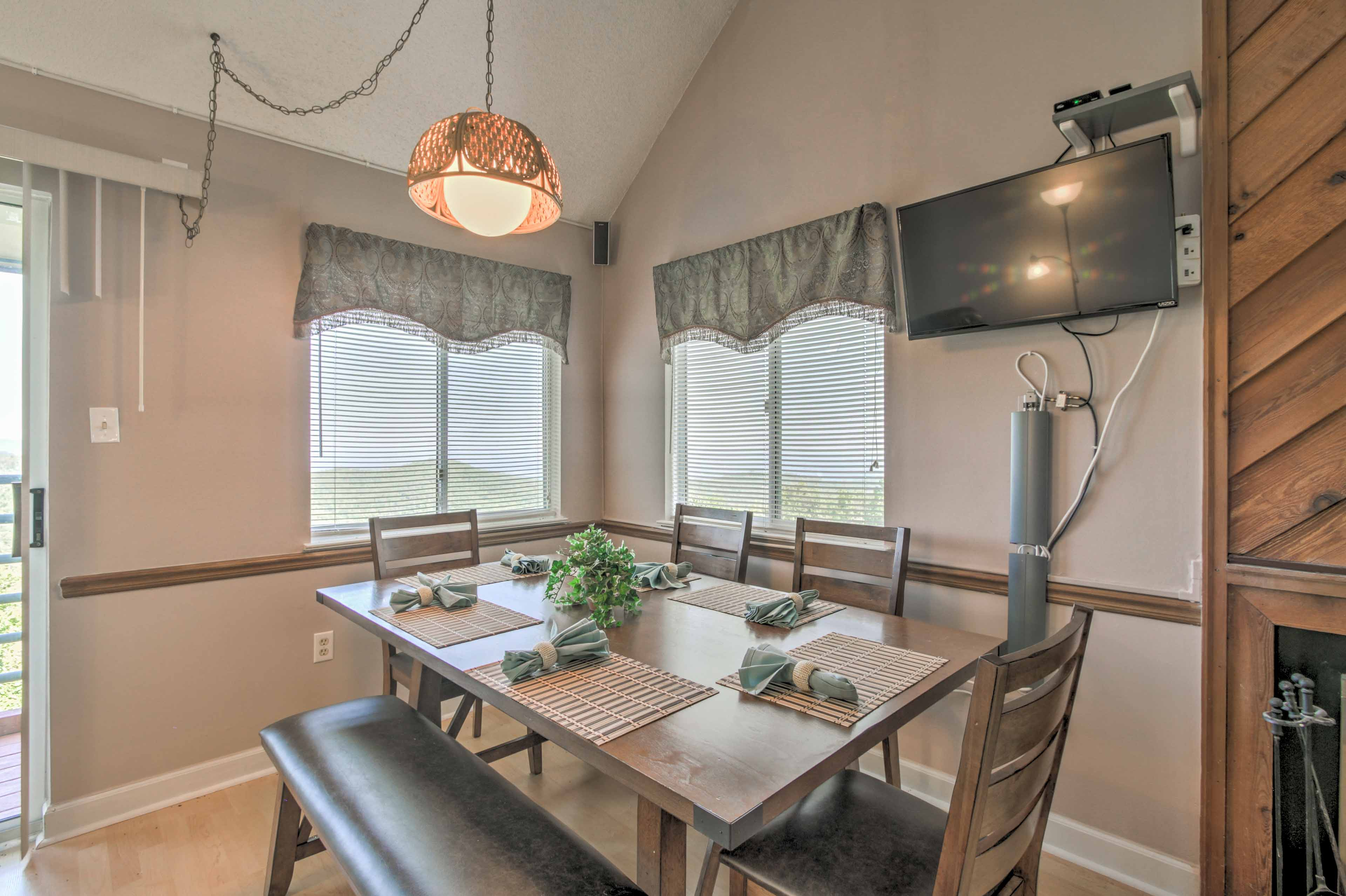 Enjoy meals gathered around the dining table.