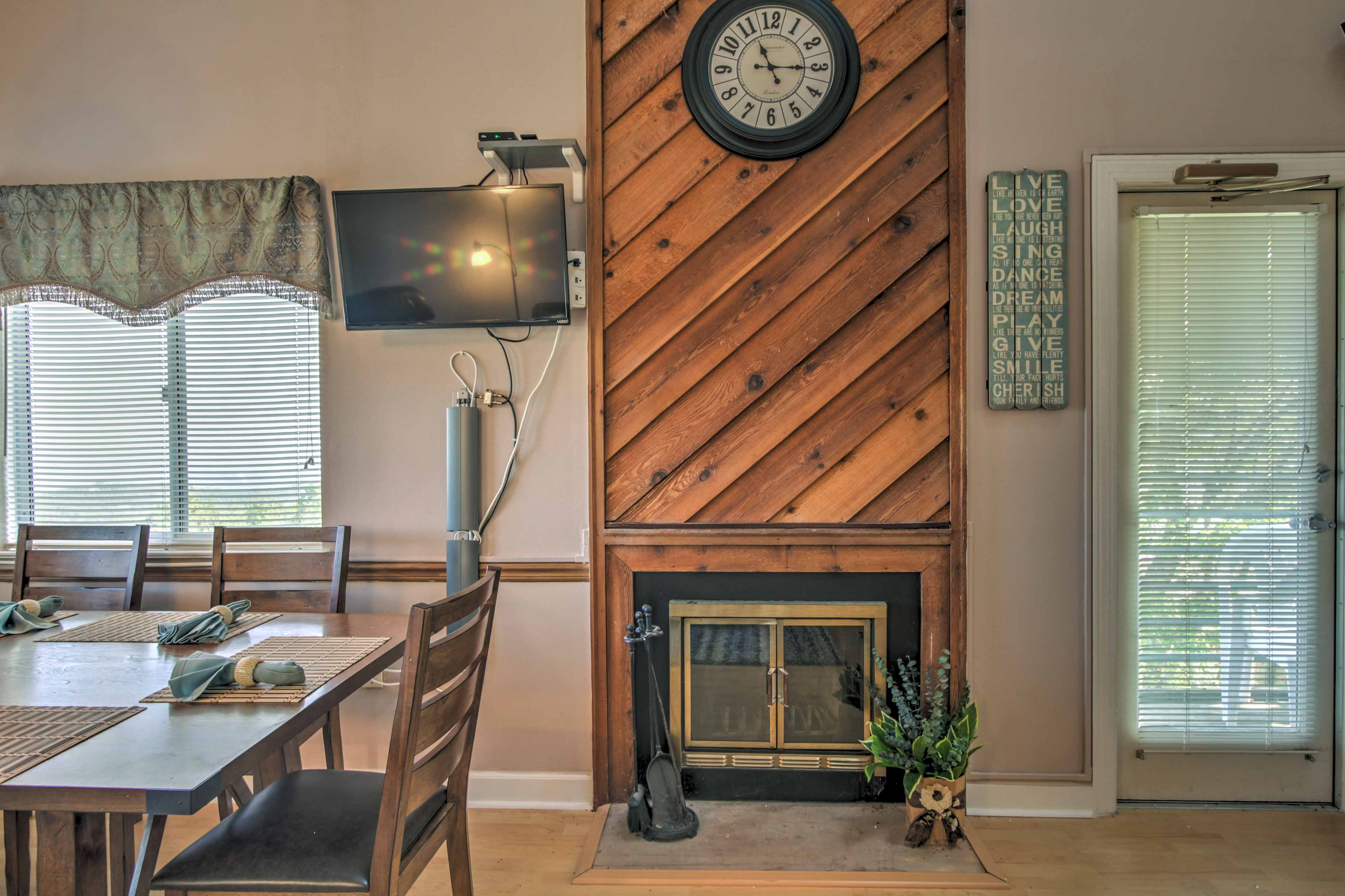 Watch a movie while cuddling close to the wood-burning fireplace.