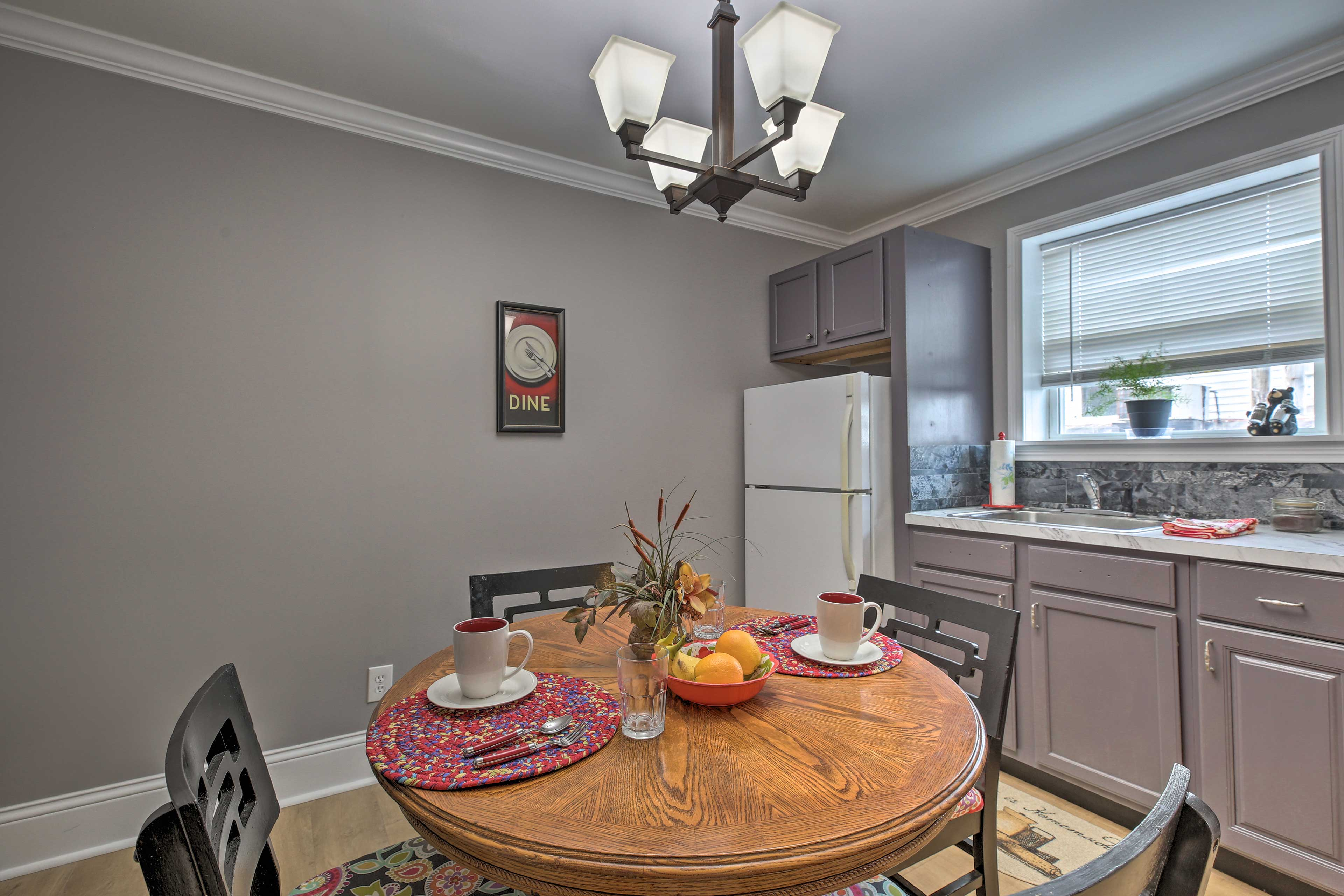 Sip a glass of wine or savor a delicious meal around the 4-person dining table.