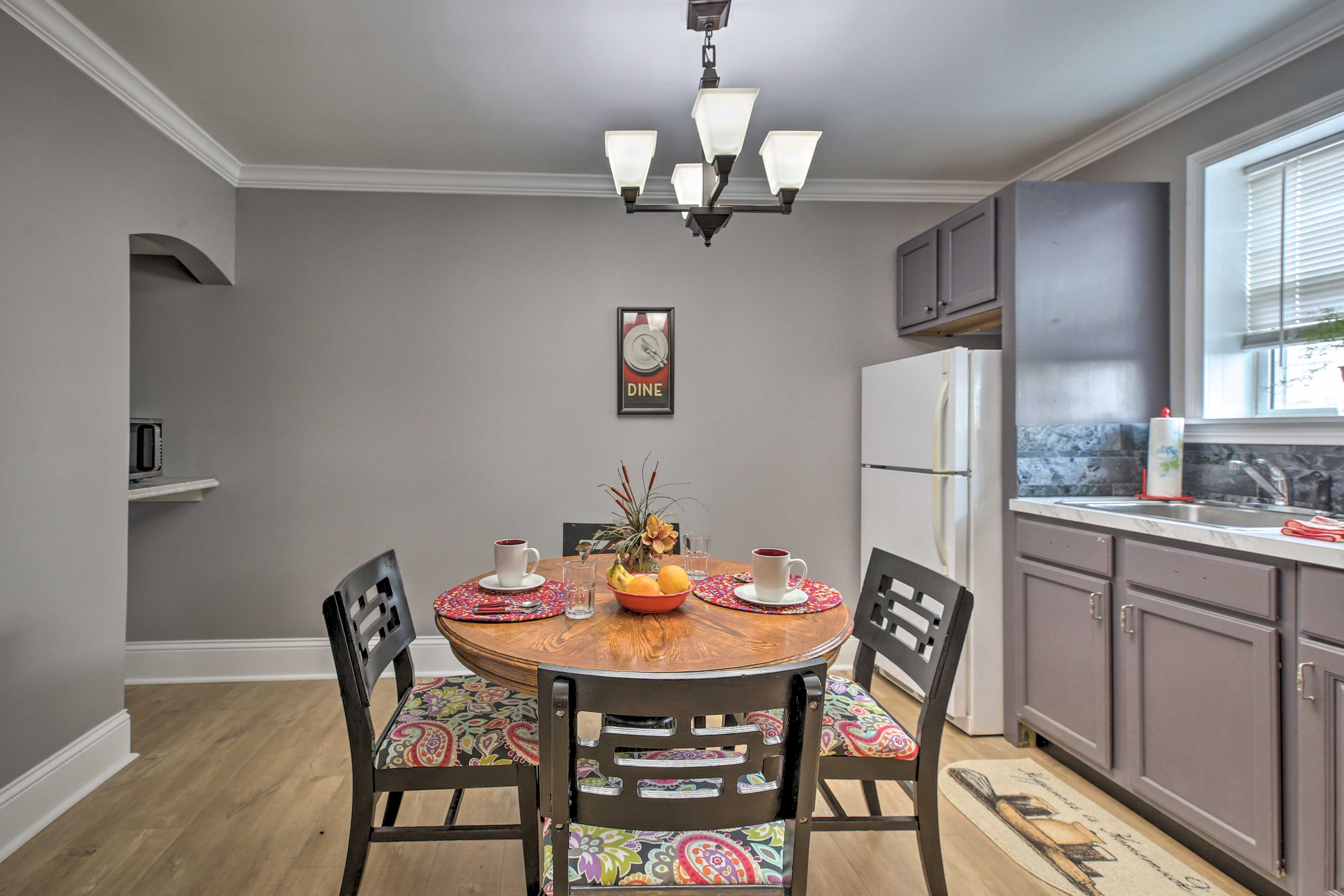 Floral embellishments of the chair cushions add color to the modern kitchen.