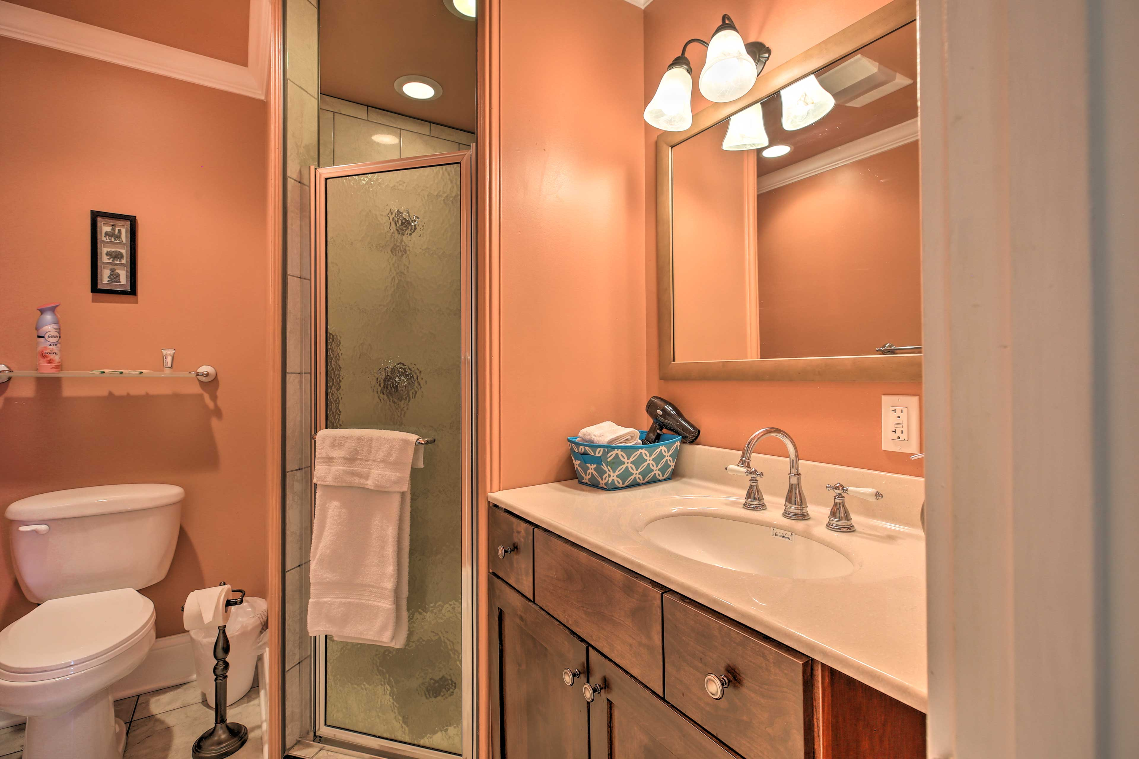 Get ready for the day in the full bathroom.