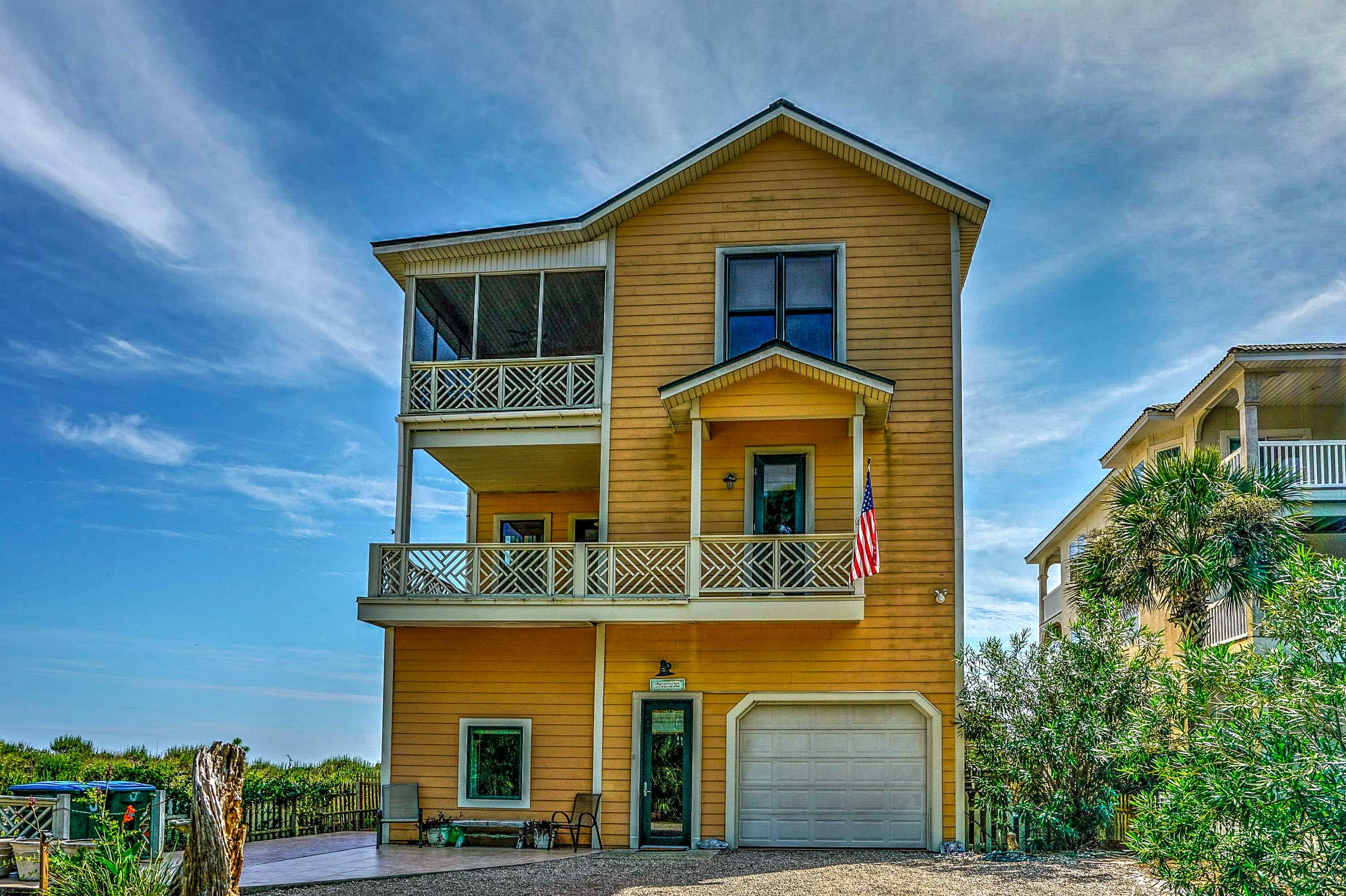This bright and cheery, 3-story home offers accommodations for 12.