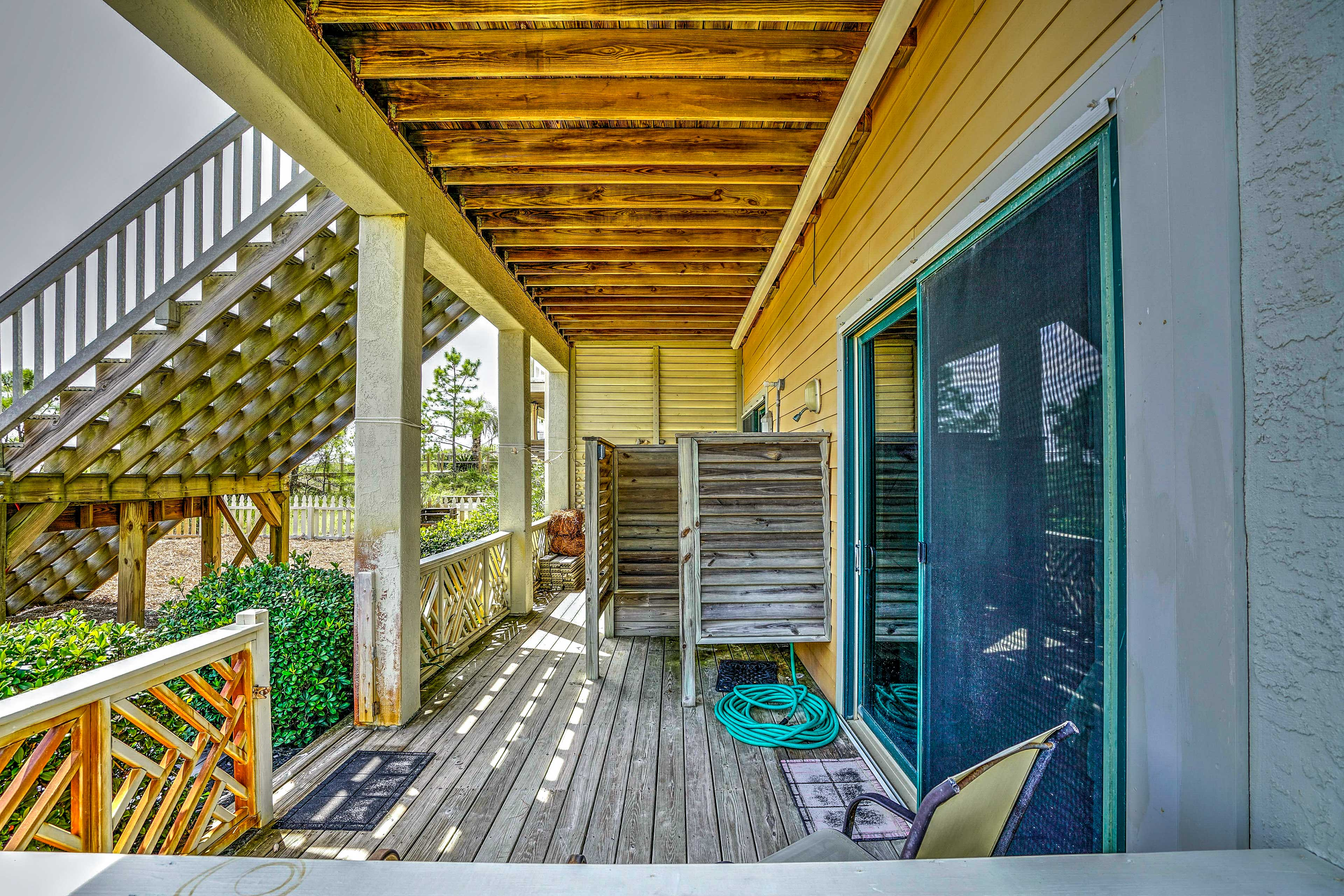 Step out onto the patio to get to the beach.