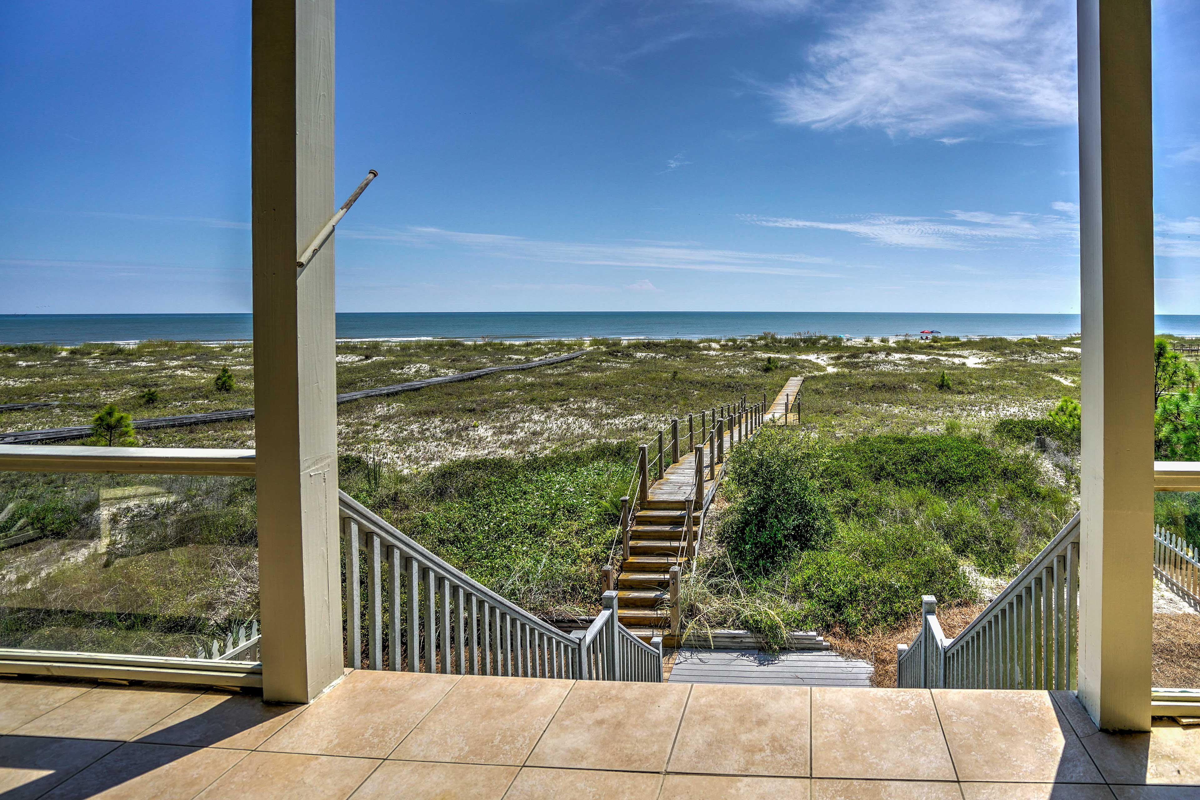 The private boardwalk leads you across the dunes to the sandy shores!