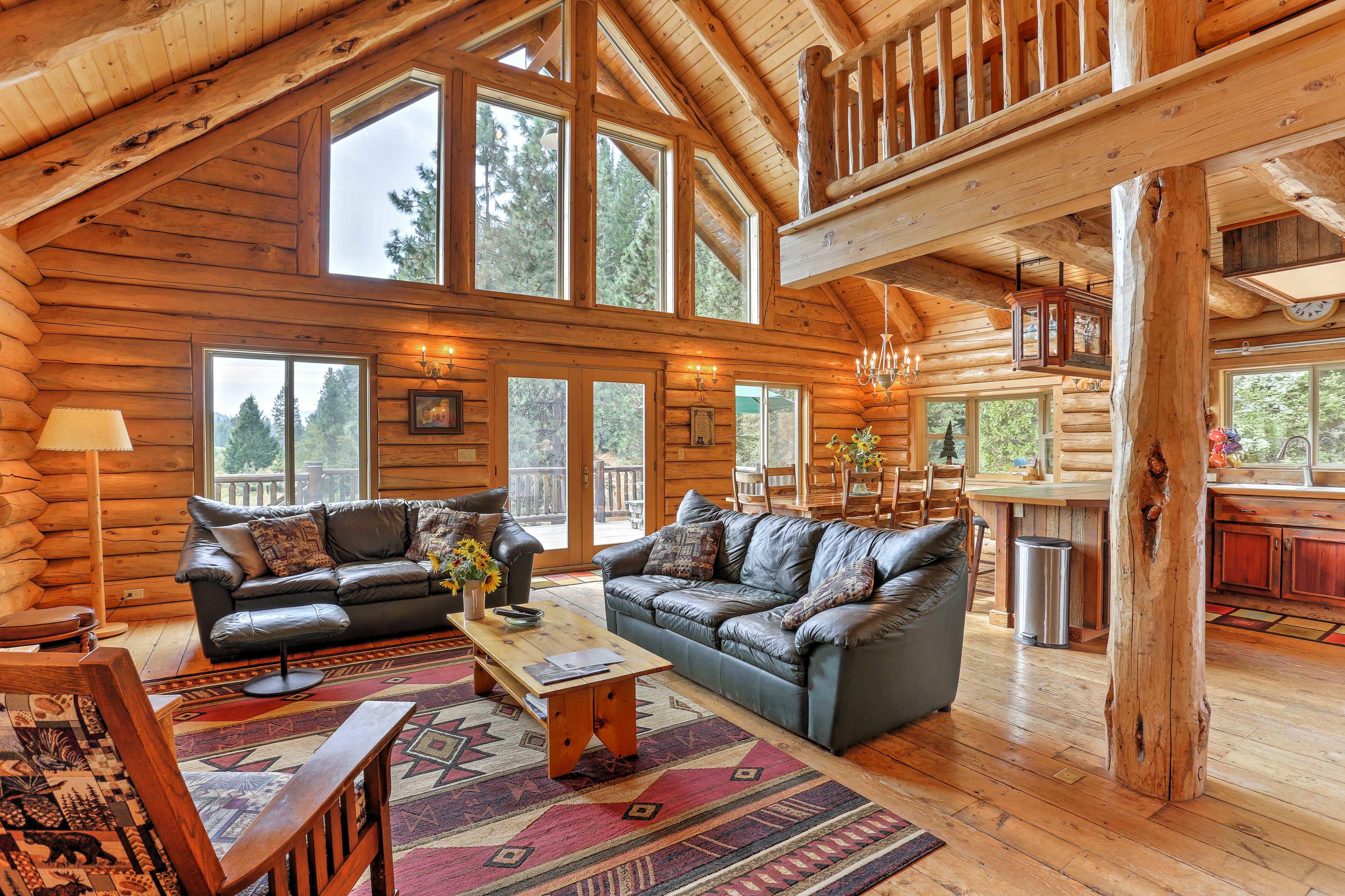 This log cabin-style 4-bedroom, 3-bath vacation rental home sleeps 10.