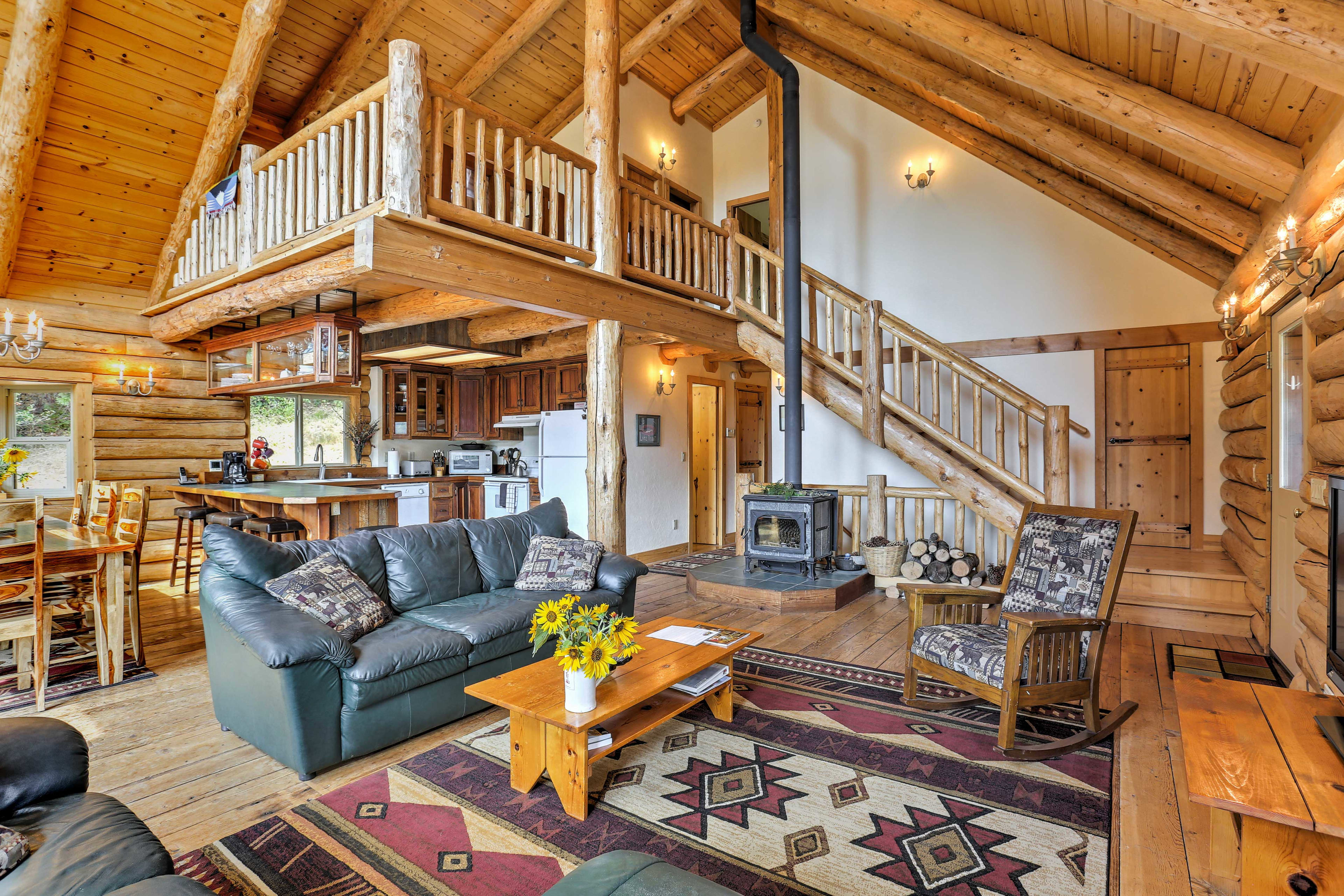 Enjoy the wood-burning stove, leather couches, and a flat-screen satellite TV.