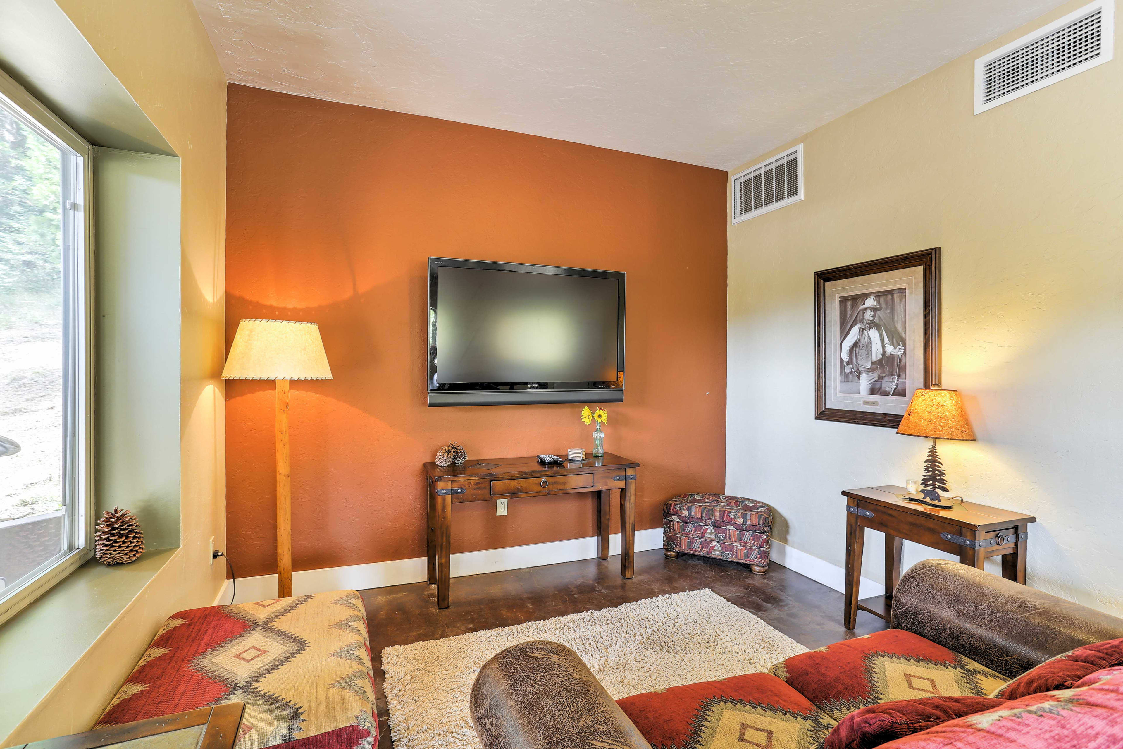 Enjoy a movie in the basement living room using the flat-screen satellite TV.
