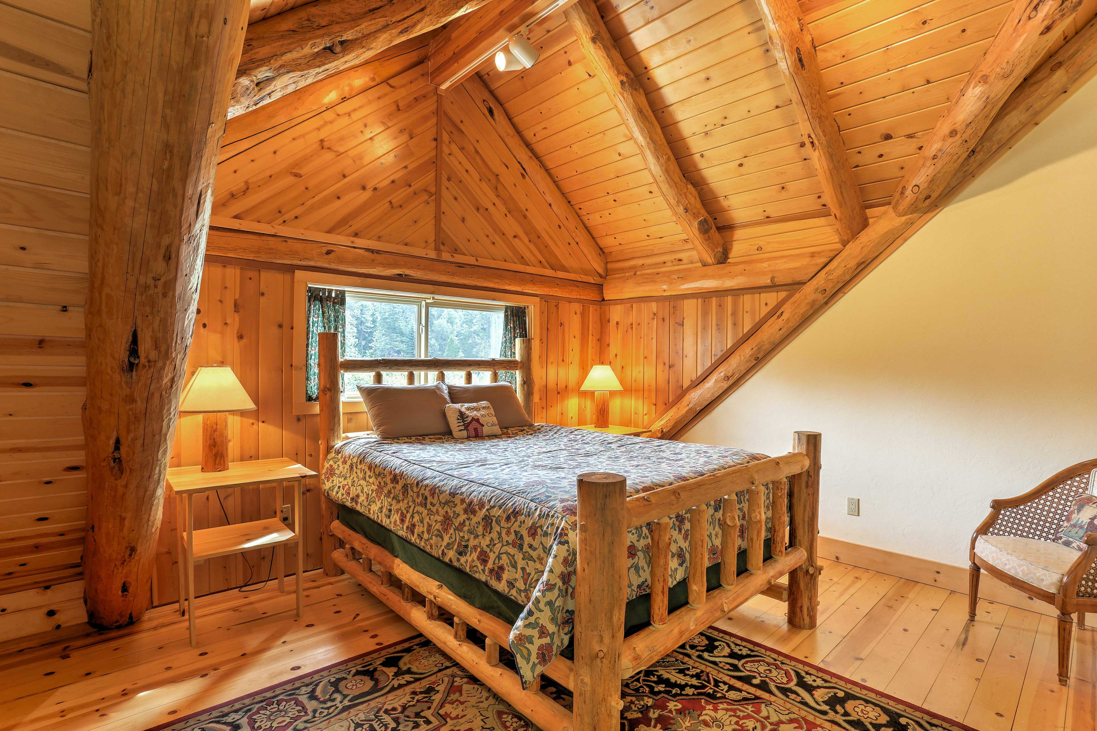 The upstairs master bedroom features a soft queen-sized bed.