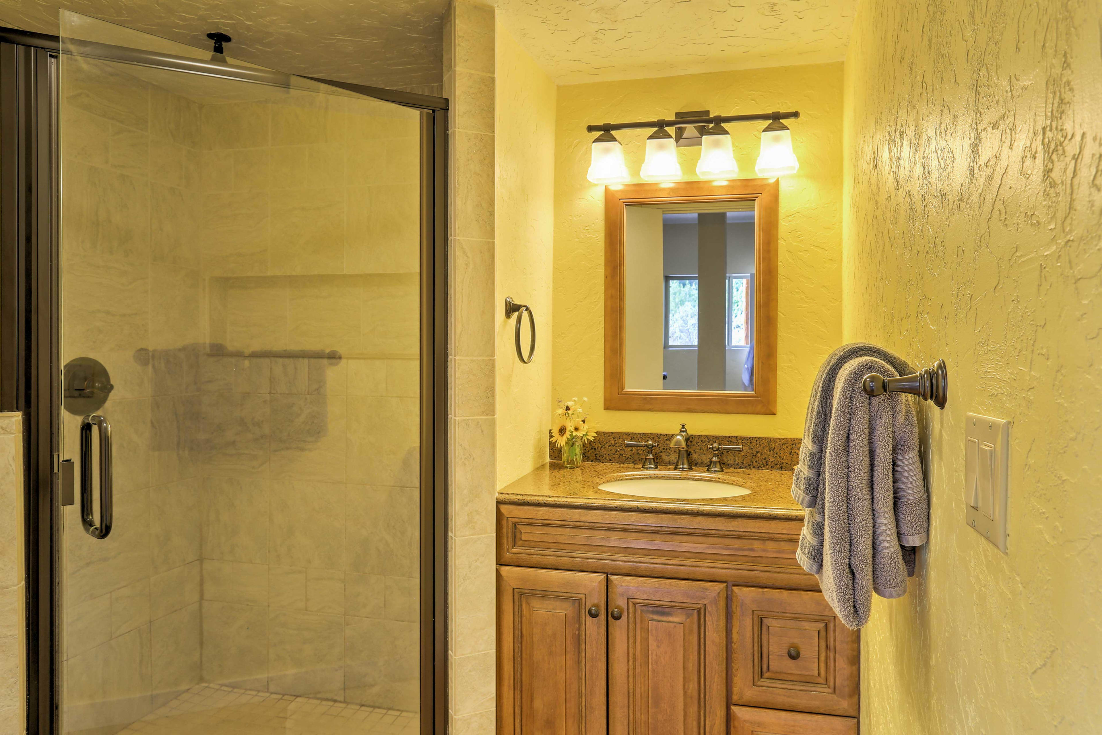 The second bathroom offers a walk-in shower.