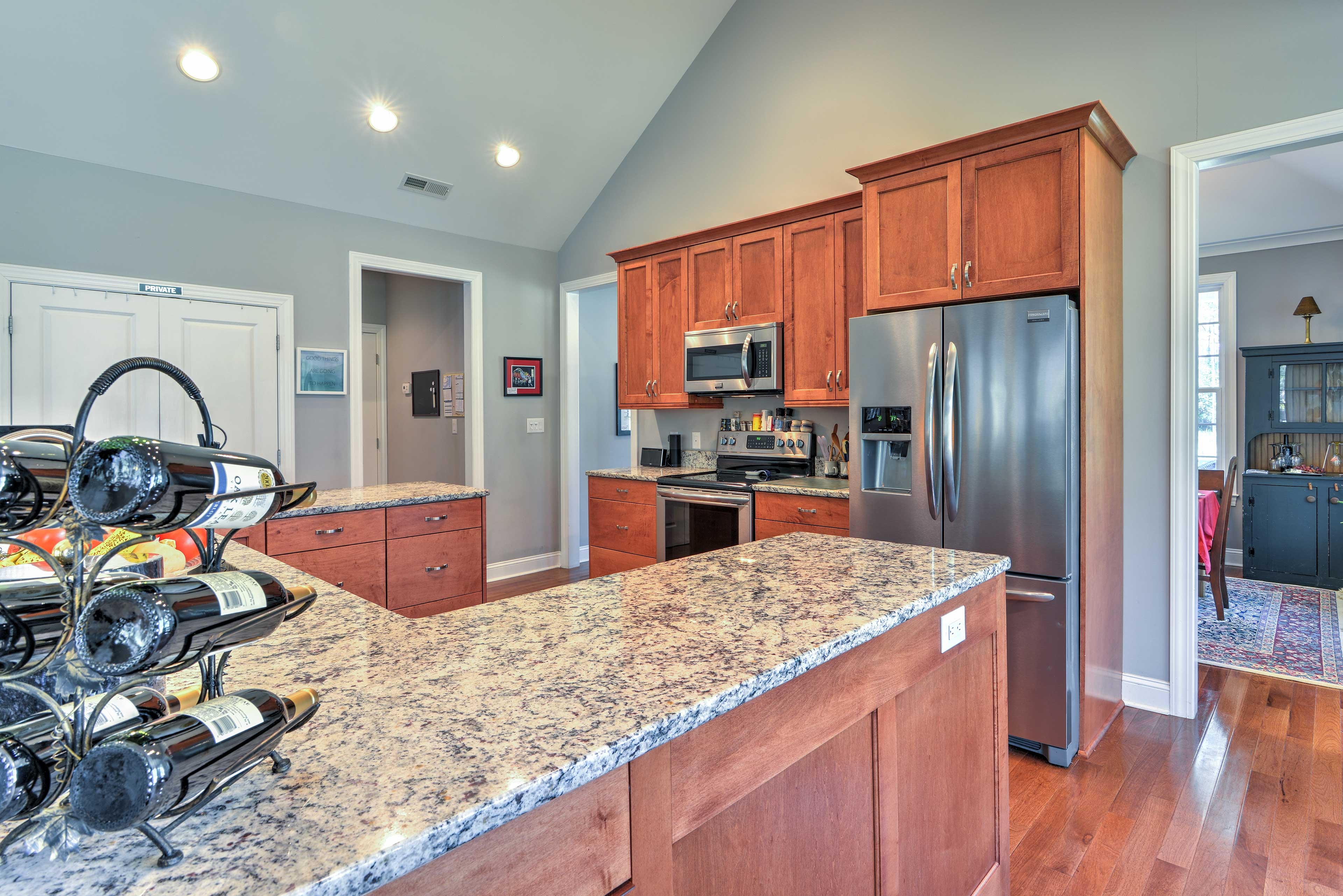 Relish the stainless steel appliances, granite counters, and natural wood elements.