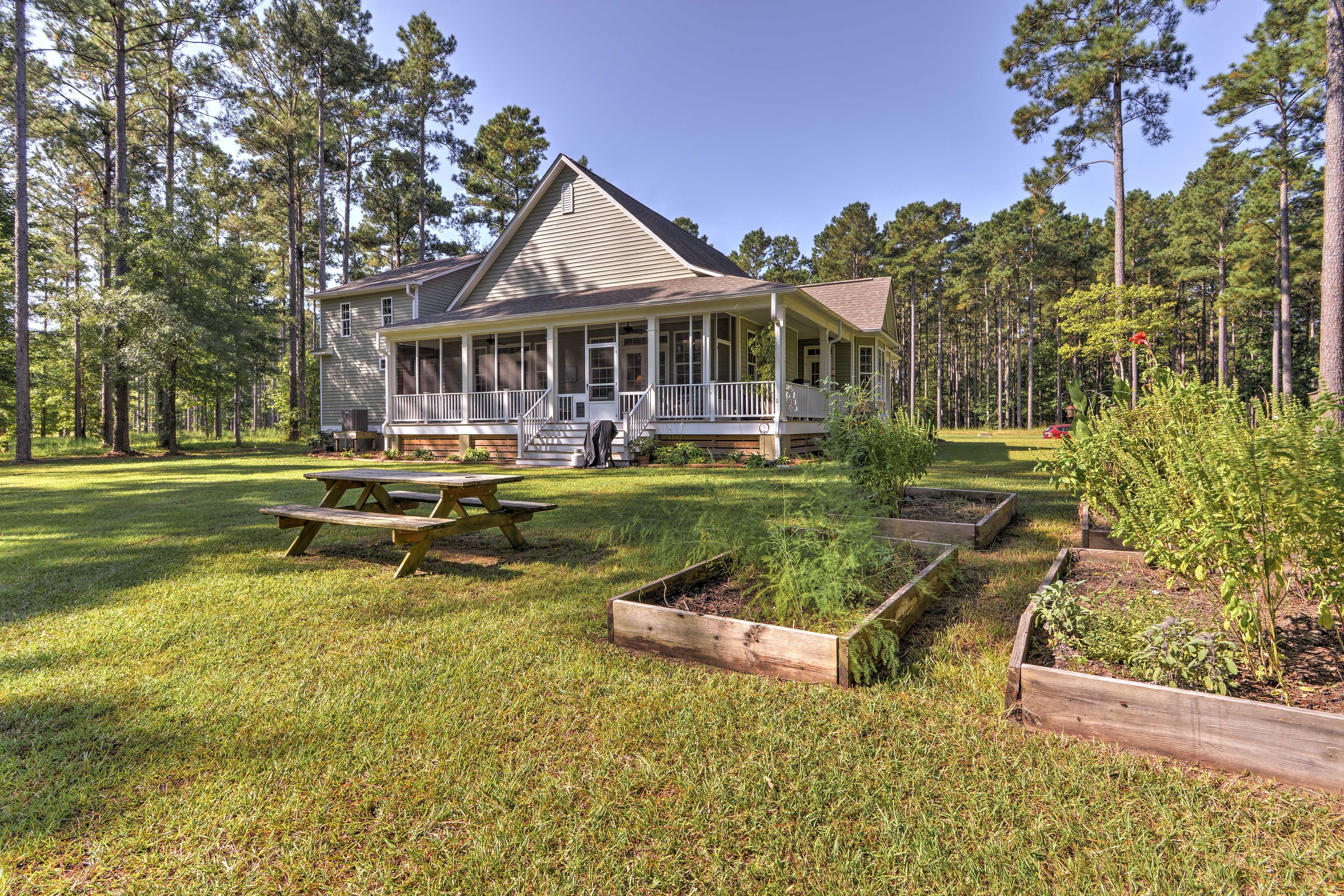 Enjoy an al fresco barbecue gathered around this outdoor picnic table.