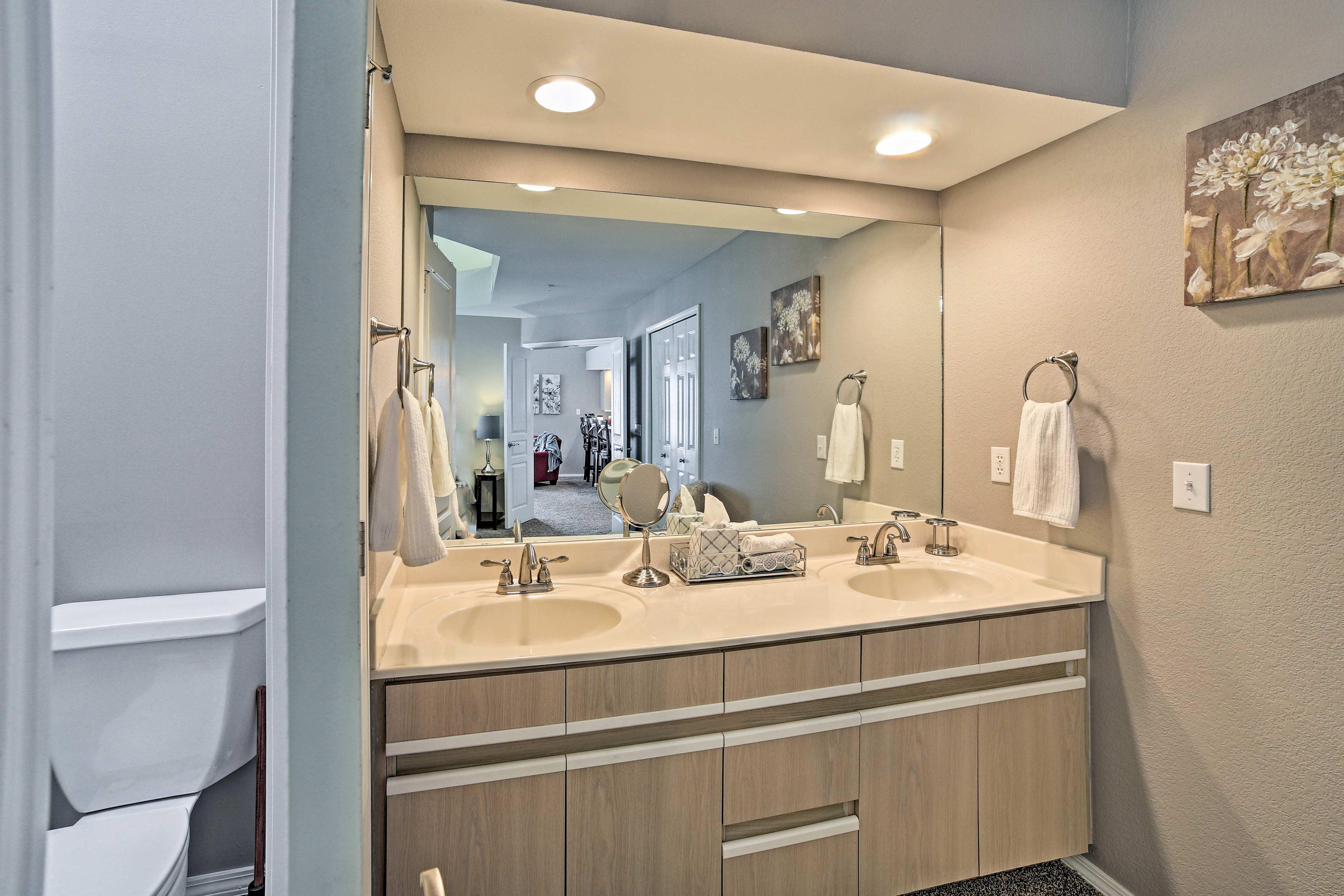You won't have to fight over mirror space thanks to the large vanity.
