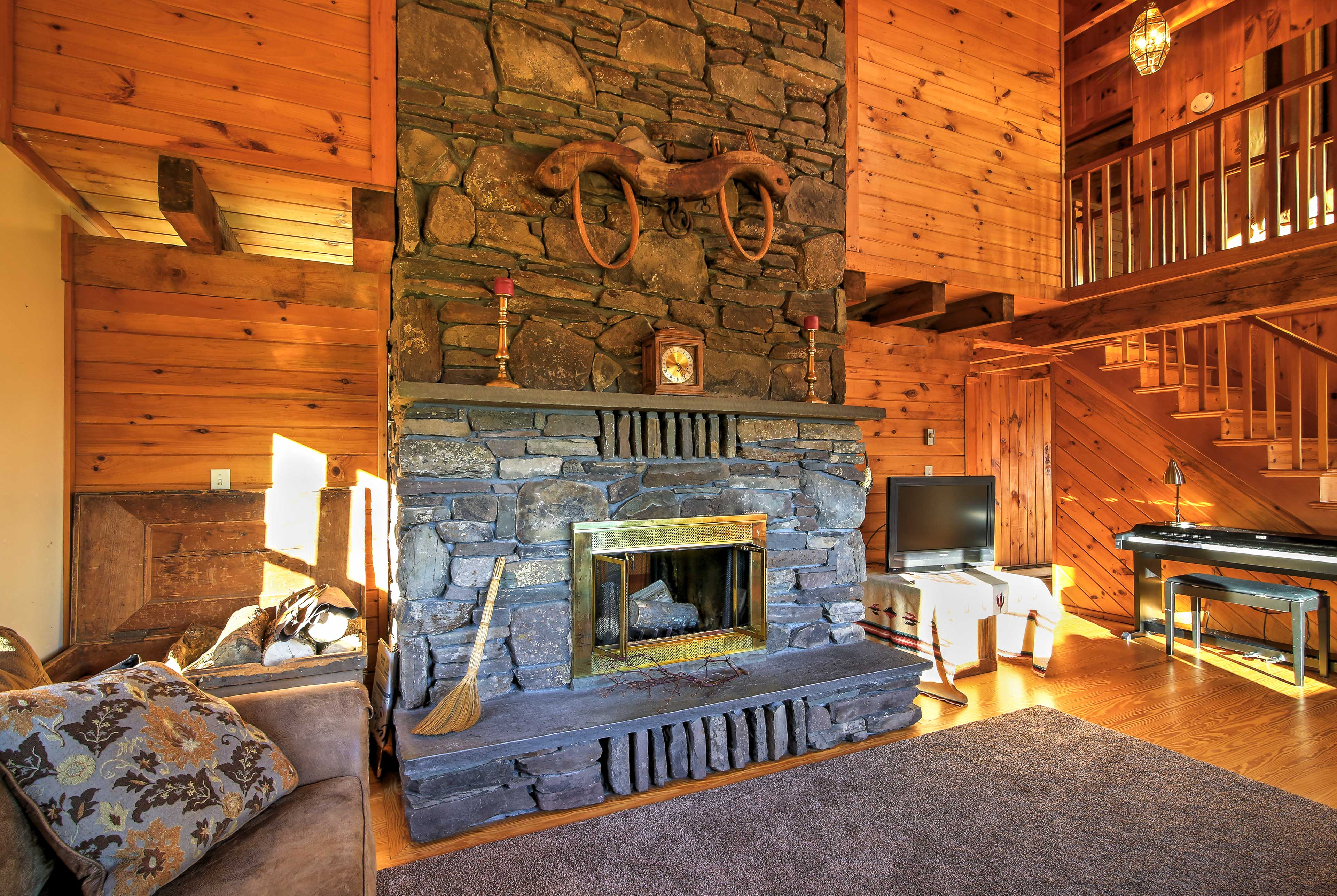 Cozy up around the stone wood-burning fireplace as you watch the flat-screen TV.