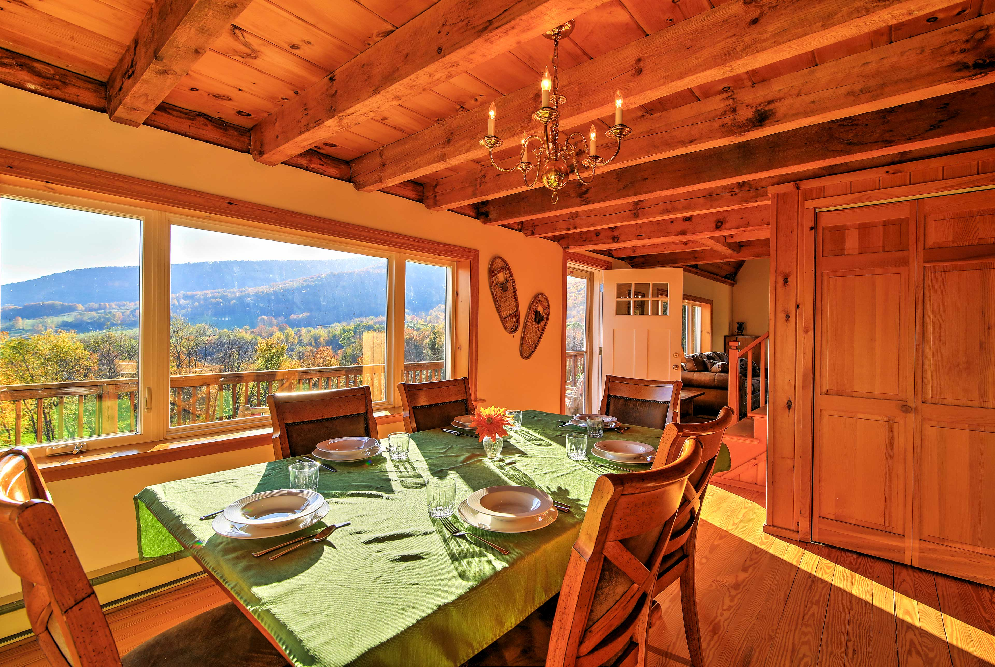 Experience dinner with a view around the 8-person dining table.