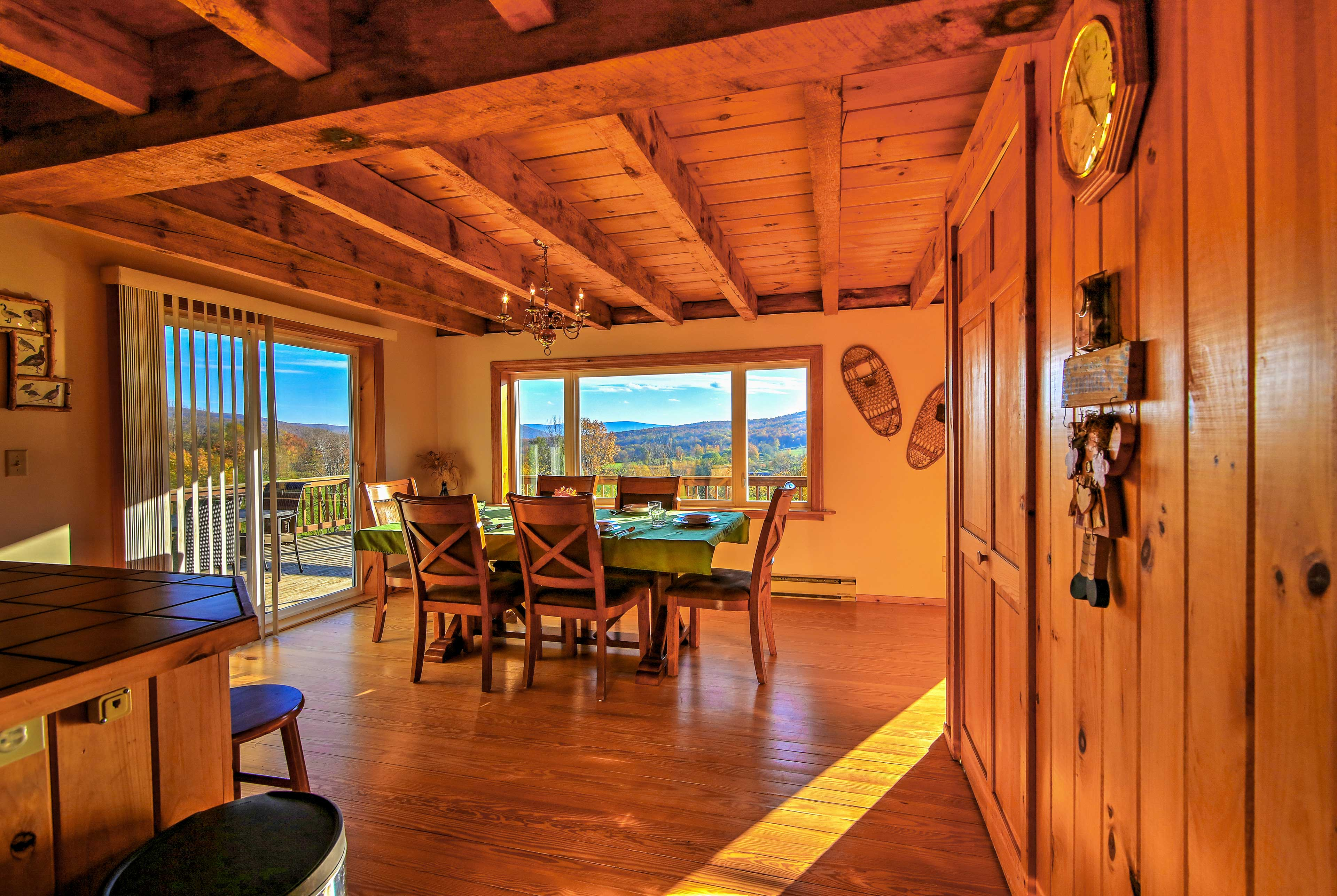 The cabin provides a warm atmosphere with wood features and rustic decor.