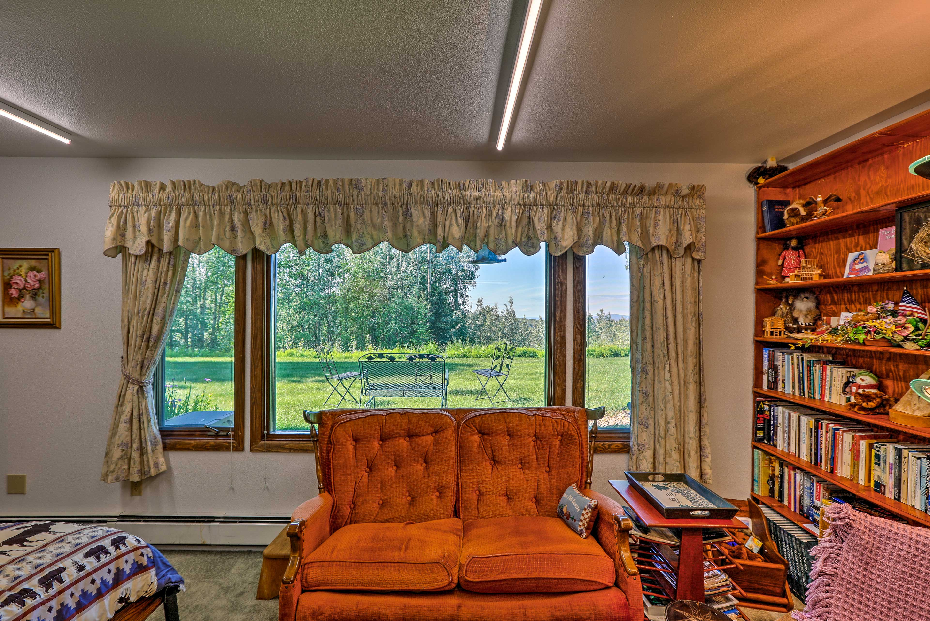 Enjoy a cup of cocoa as you rest on the rocking chair or vibrant 2-person couch.