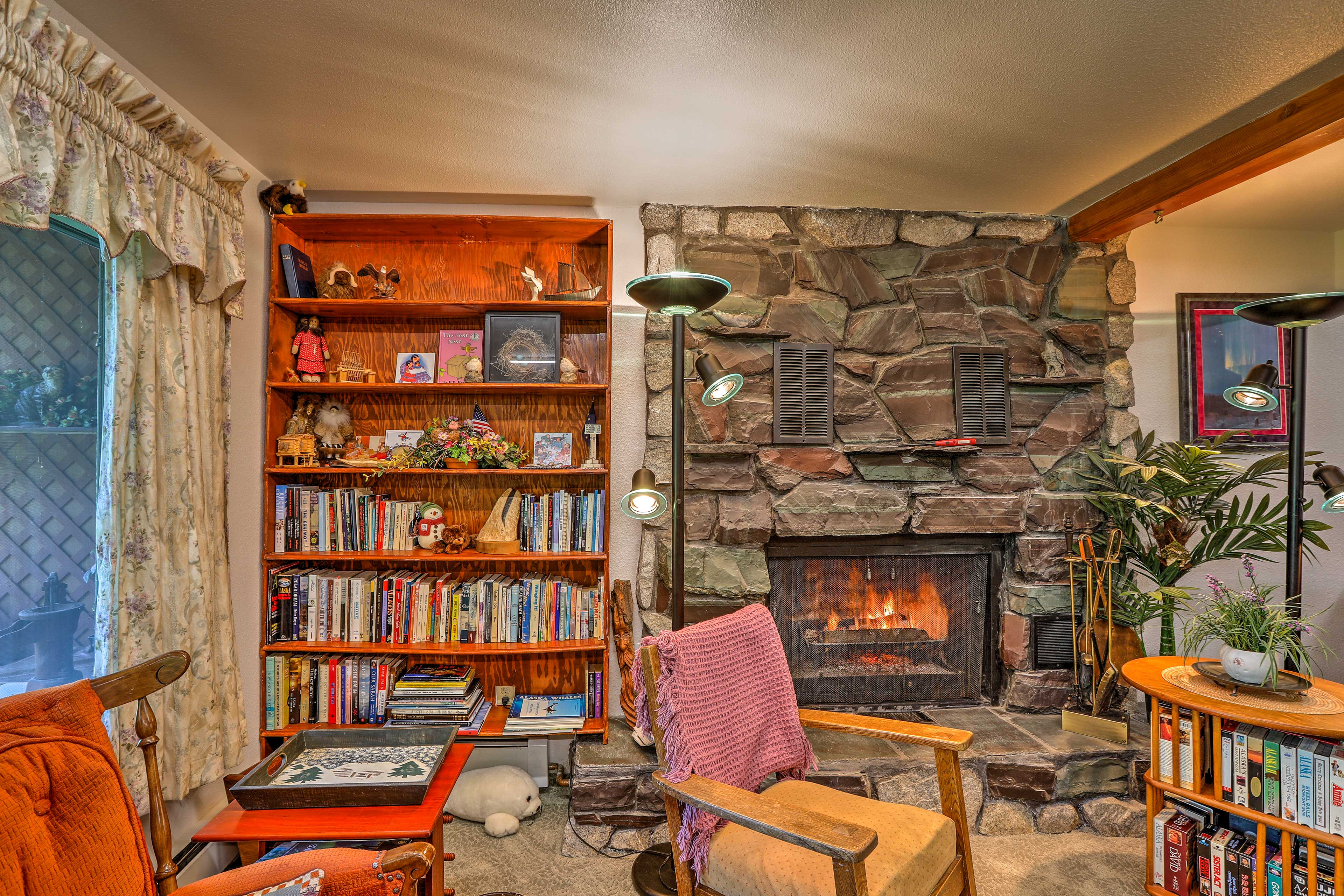 The wood-burning stone fireplace will fill the whole studio with warmth.