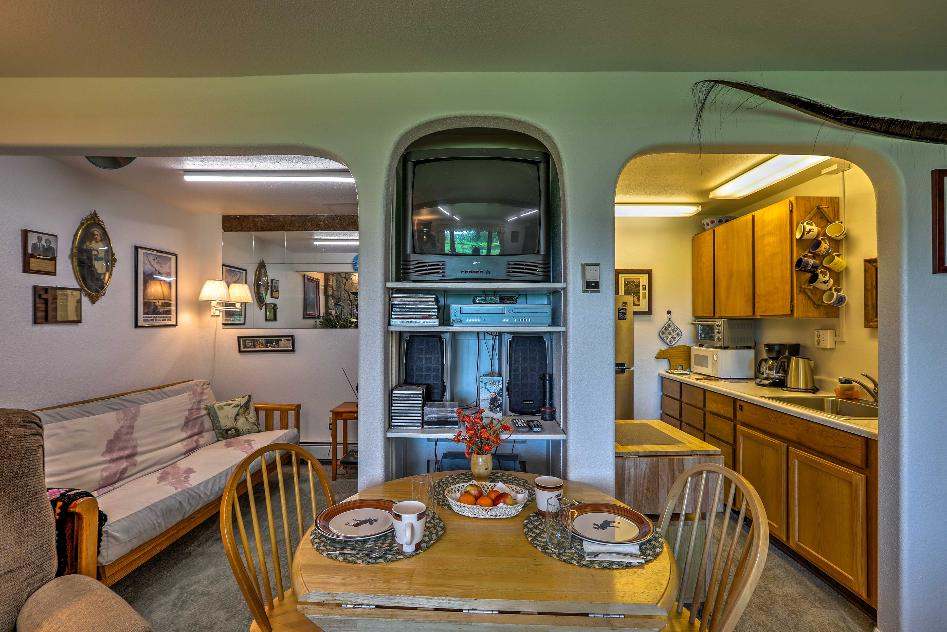 Enjoy dinner around the 4-person dining table adjacent to the kitchen.
