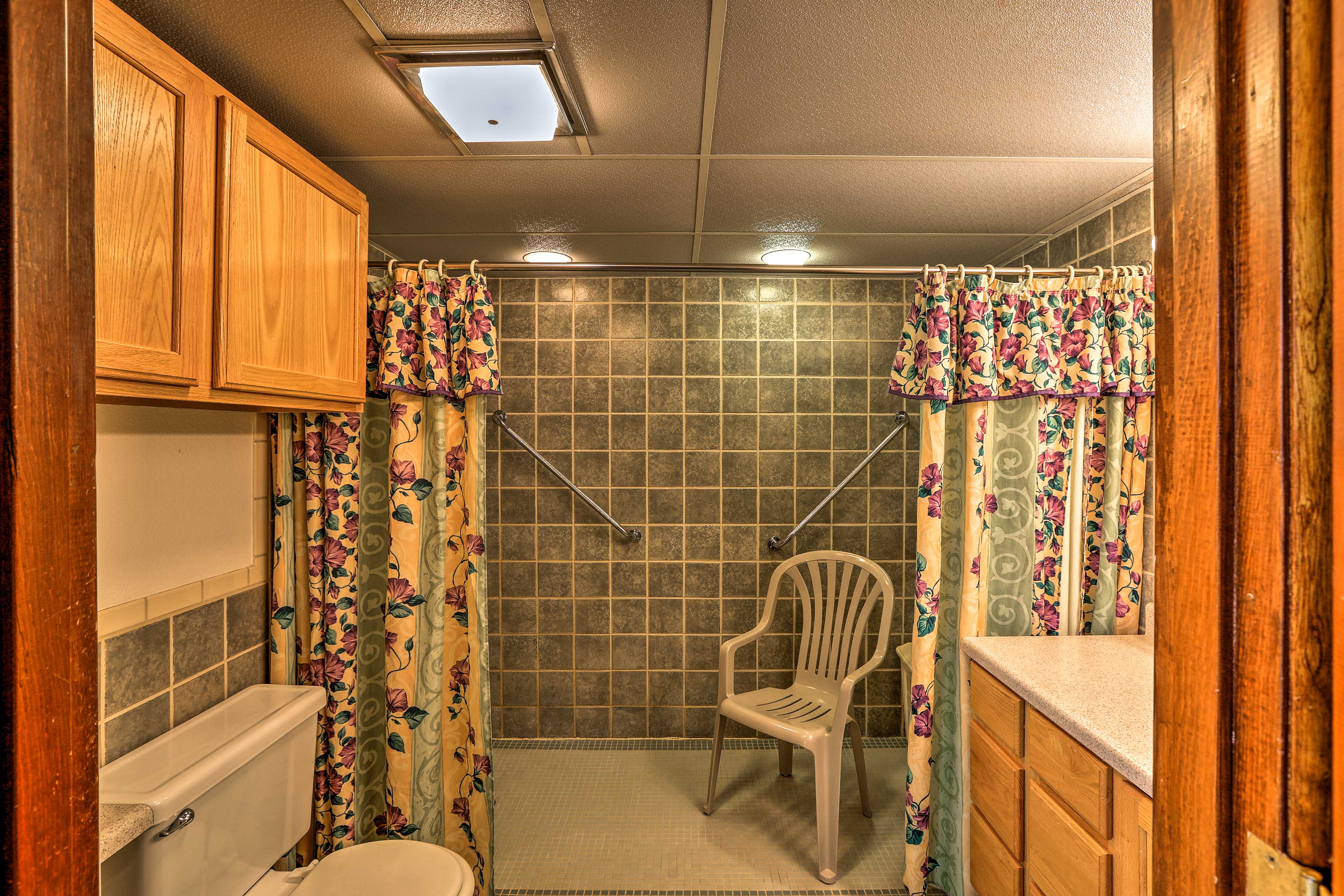 The full bathroom is handicap accessible equipped with a large shower.