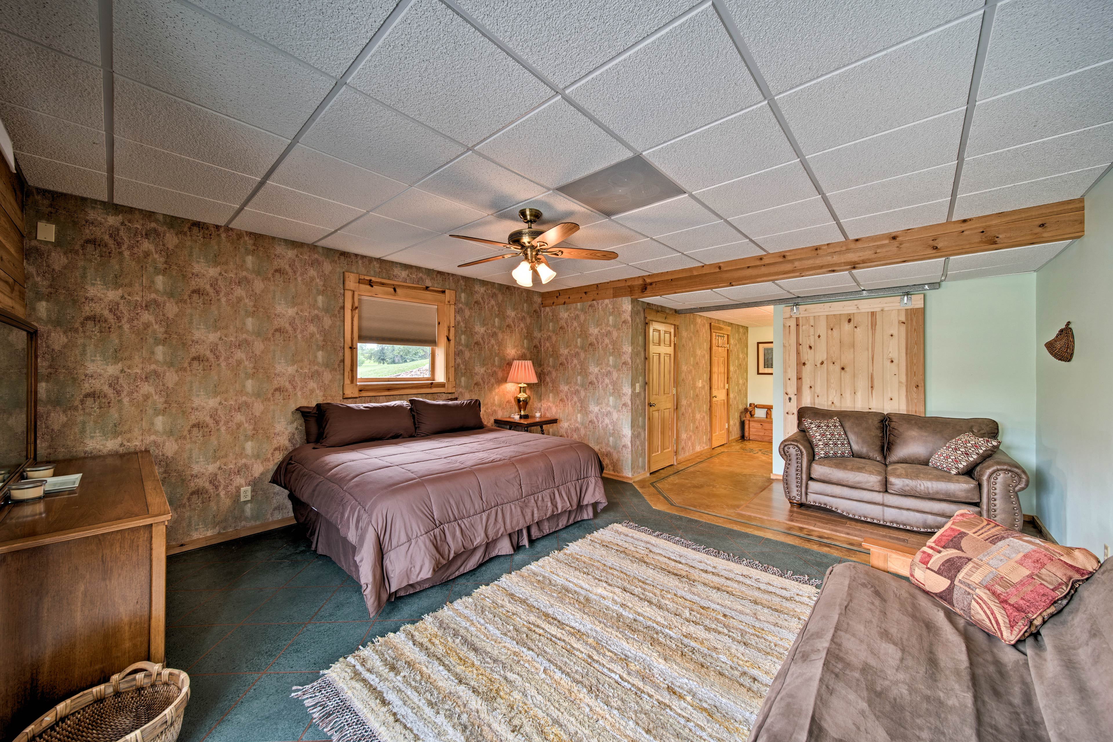 This king bed easily sleeps 2! More accommodations are available on the futon.
