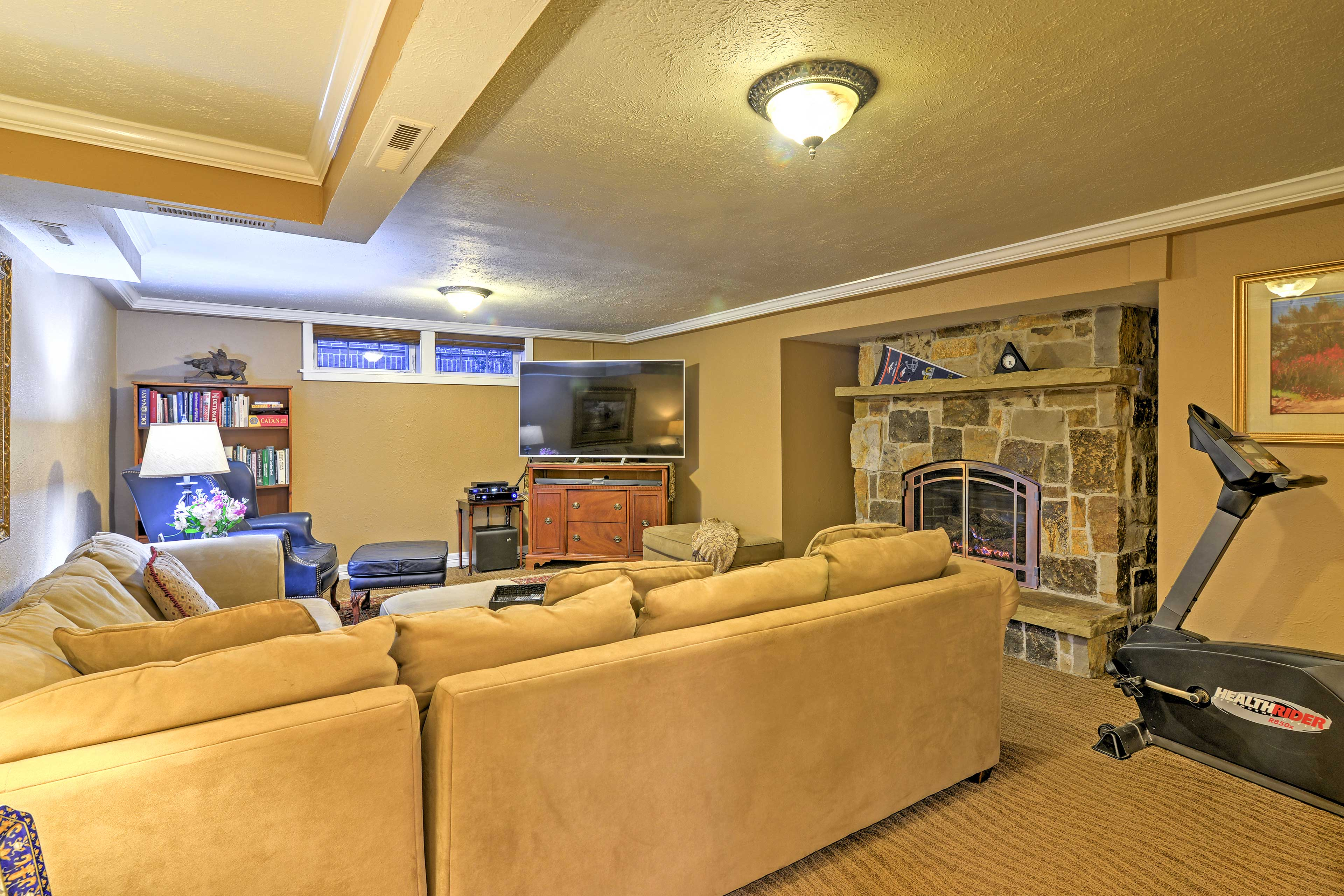 The cozy living area features a gas fireplace and 65-inch flat-screen Smart TV.