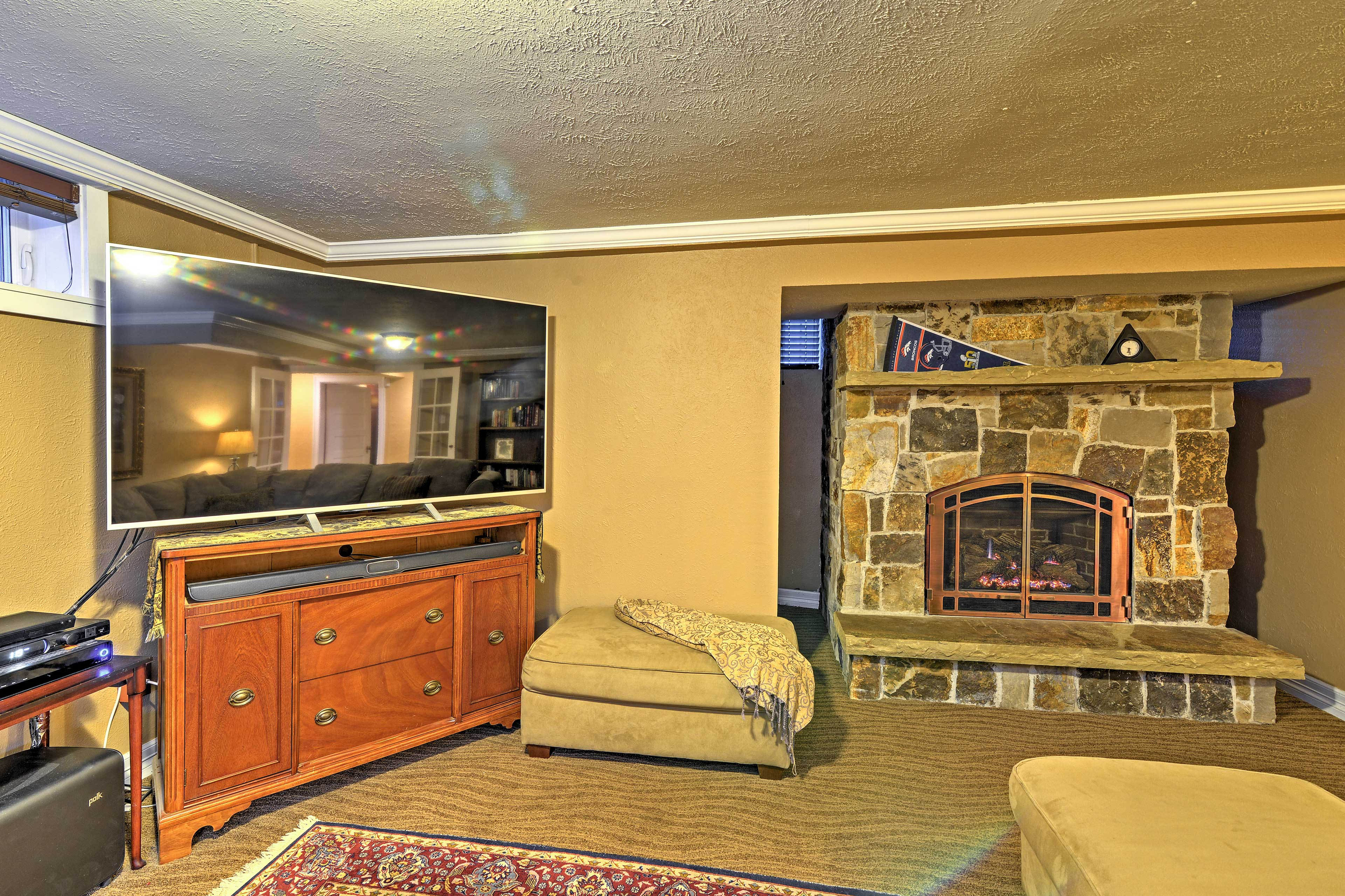 Stay warm by the gas fireplace while watching TV.