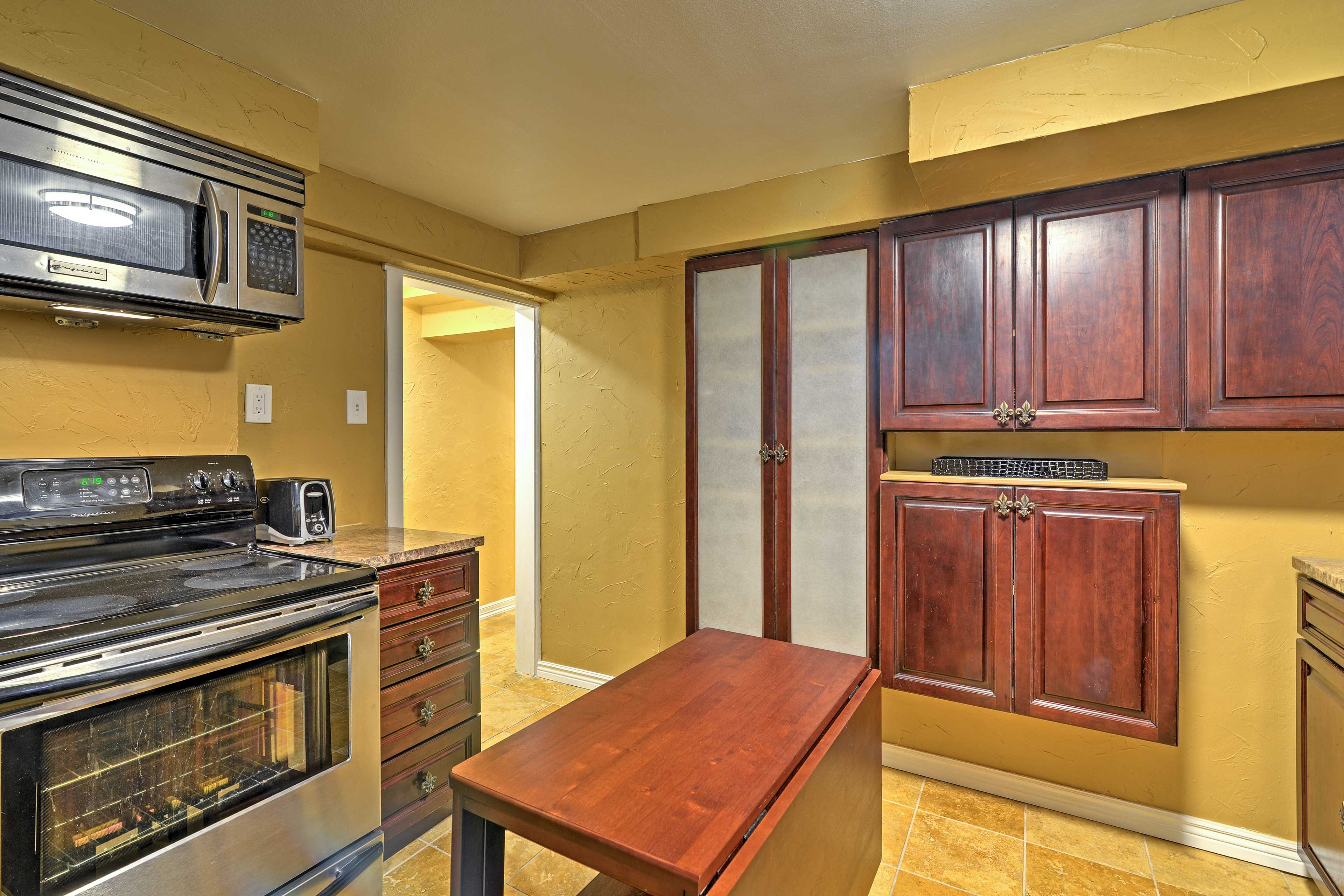 The kitchen features all appliances necessary.