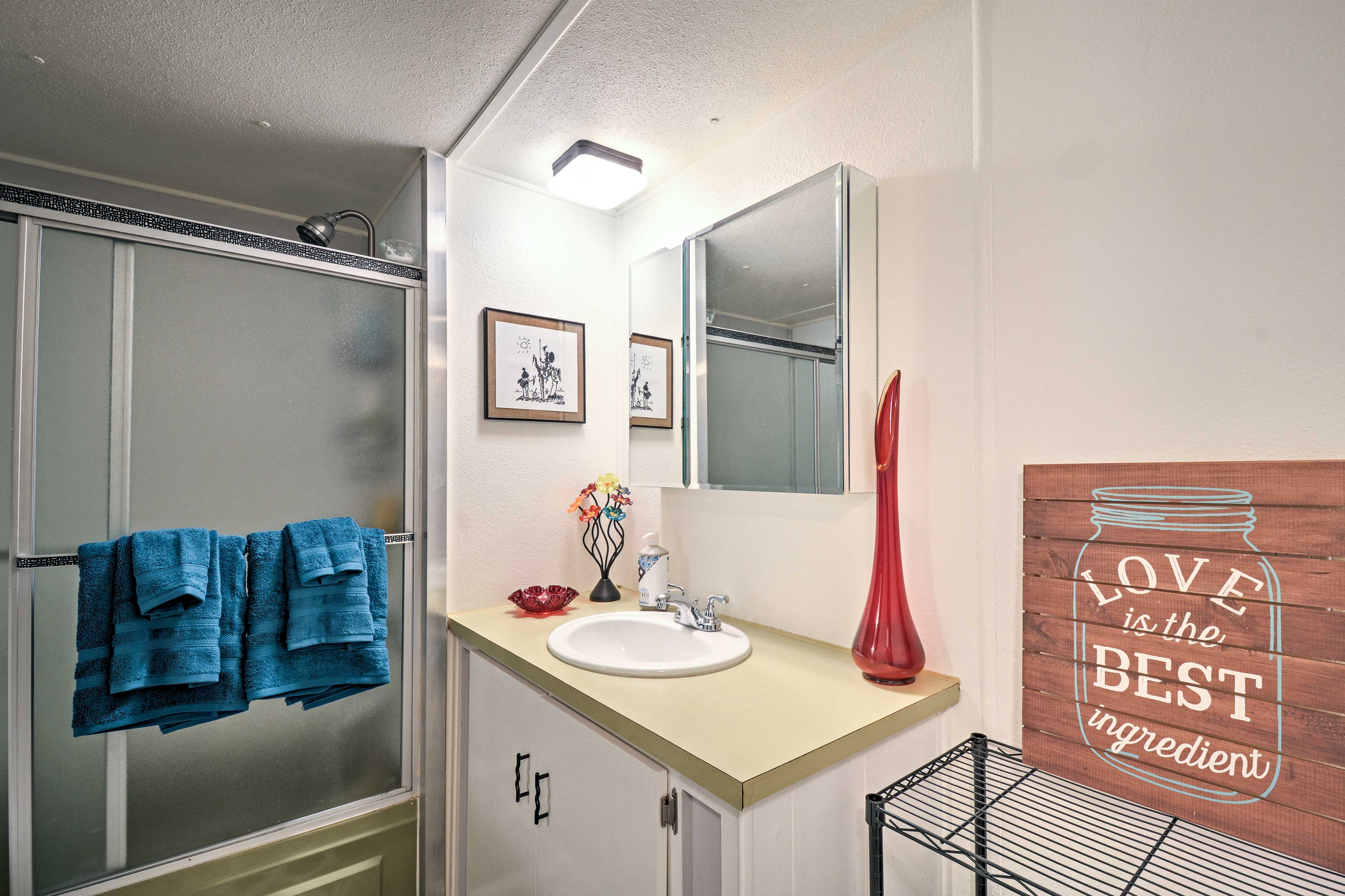 The second bathroom offers a spacious walk-in shower.