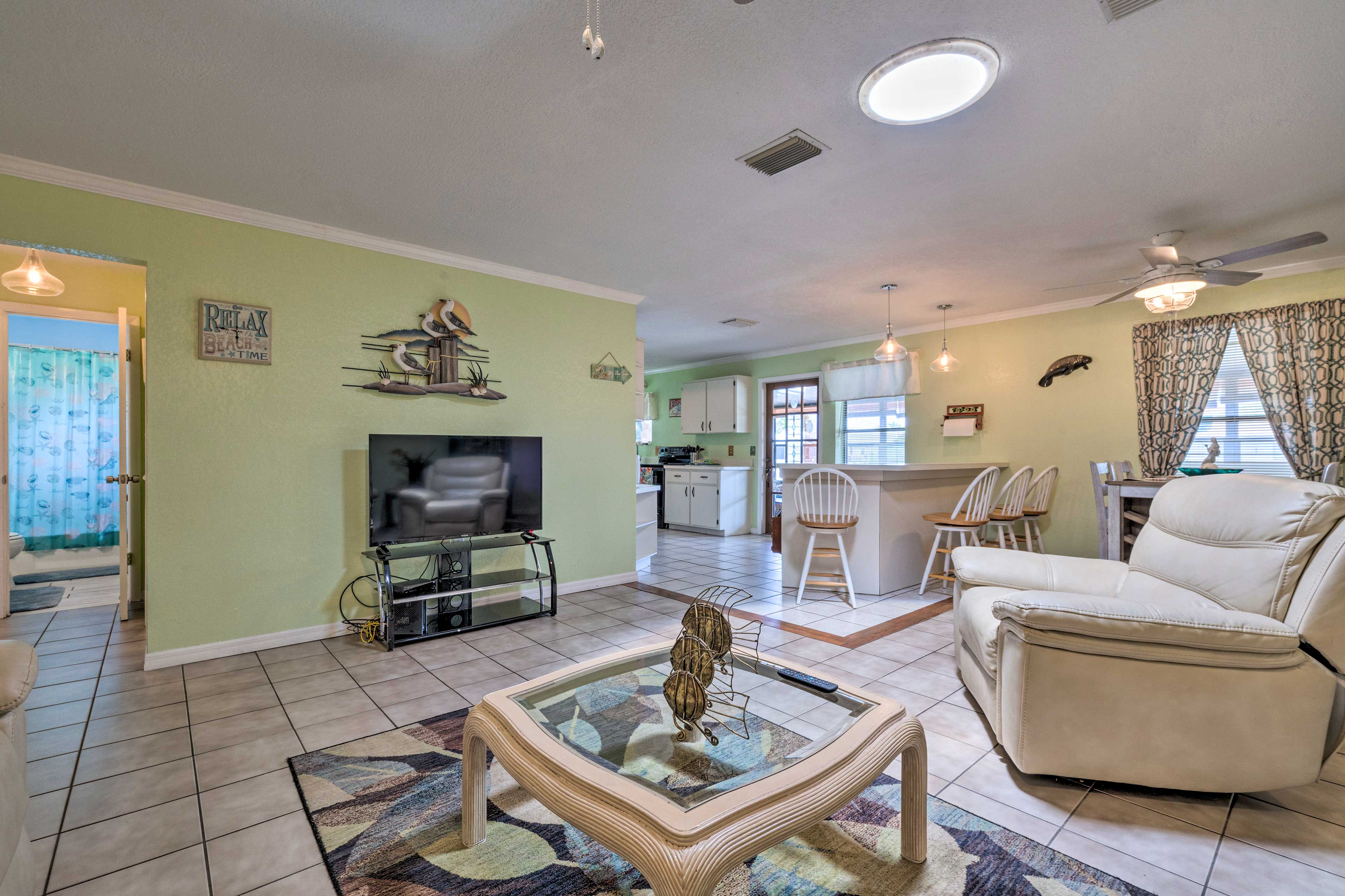 Situated along Gulf access canals, this home boasts a private dock and more!