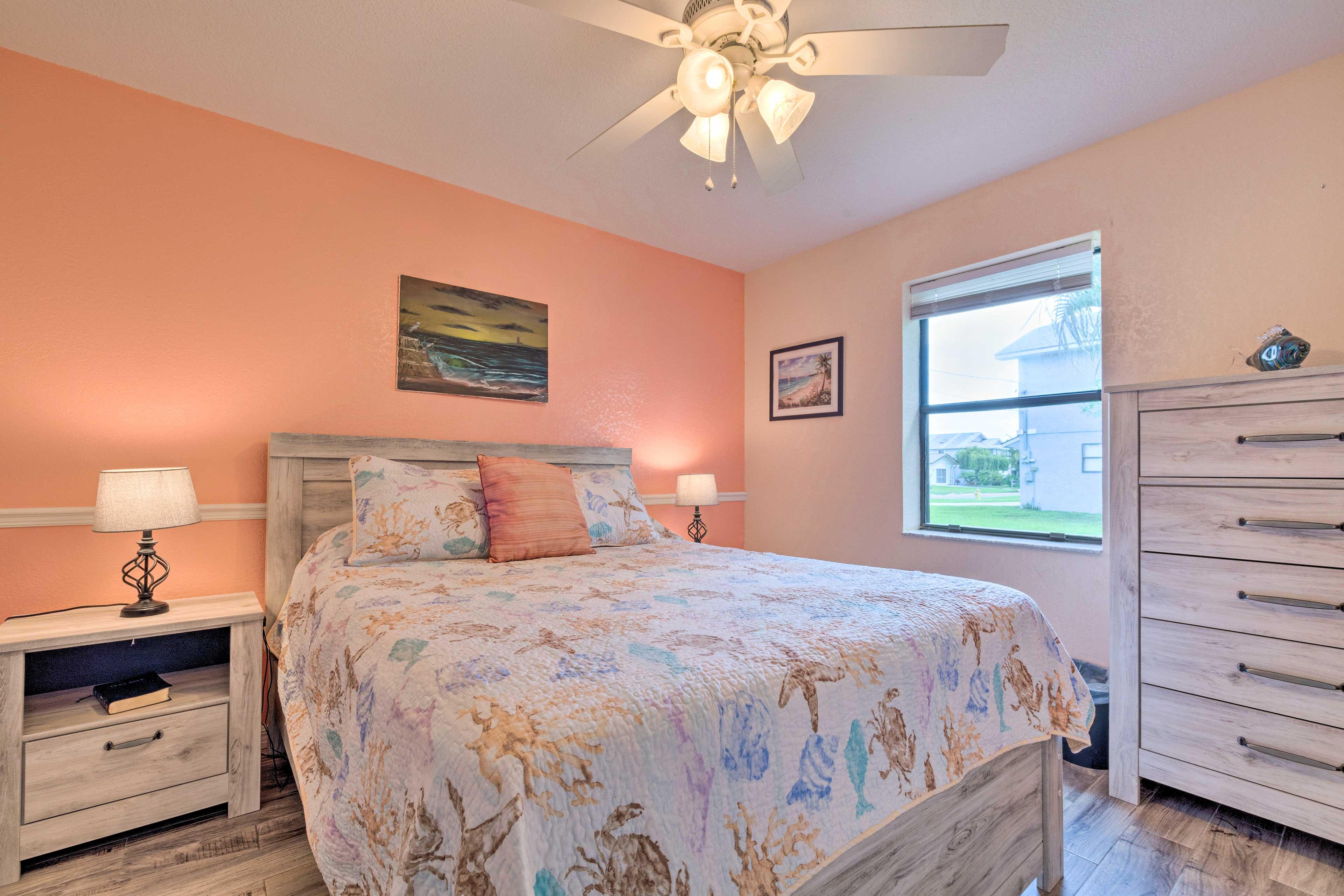 Bedroom 2 features a queen bed.