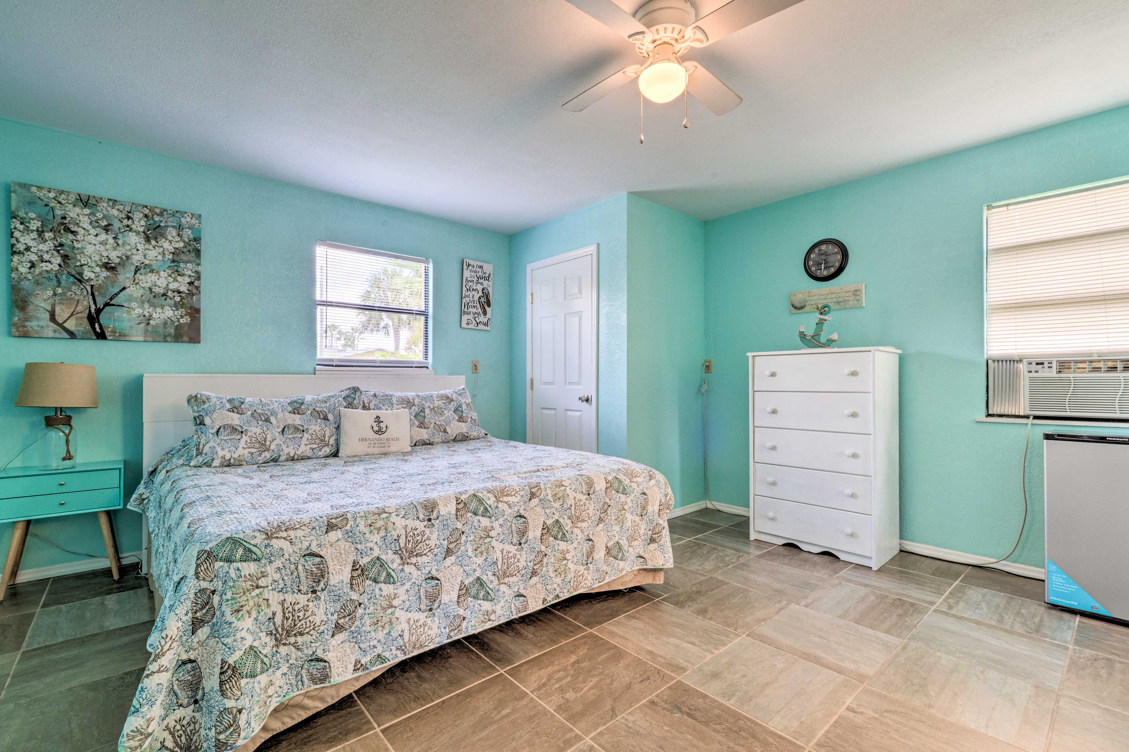 The master bedroom boasts a cozy king bed.
