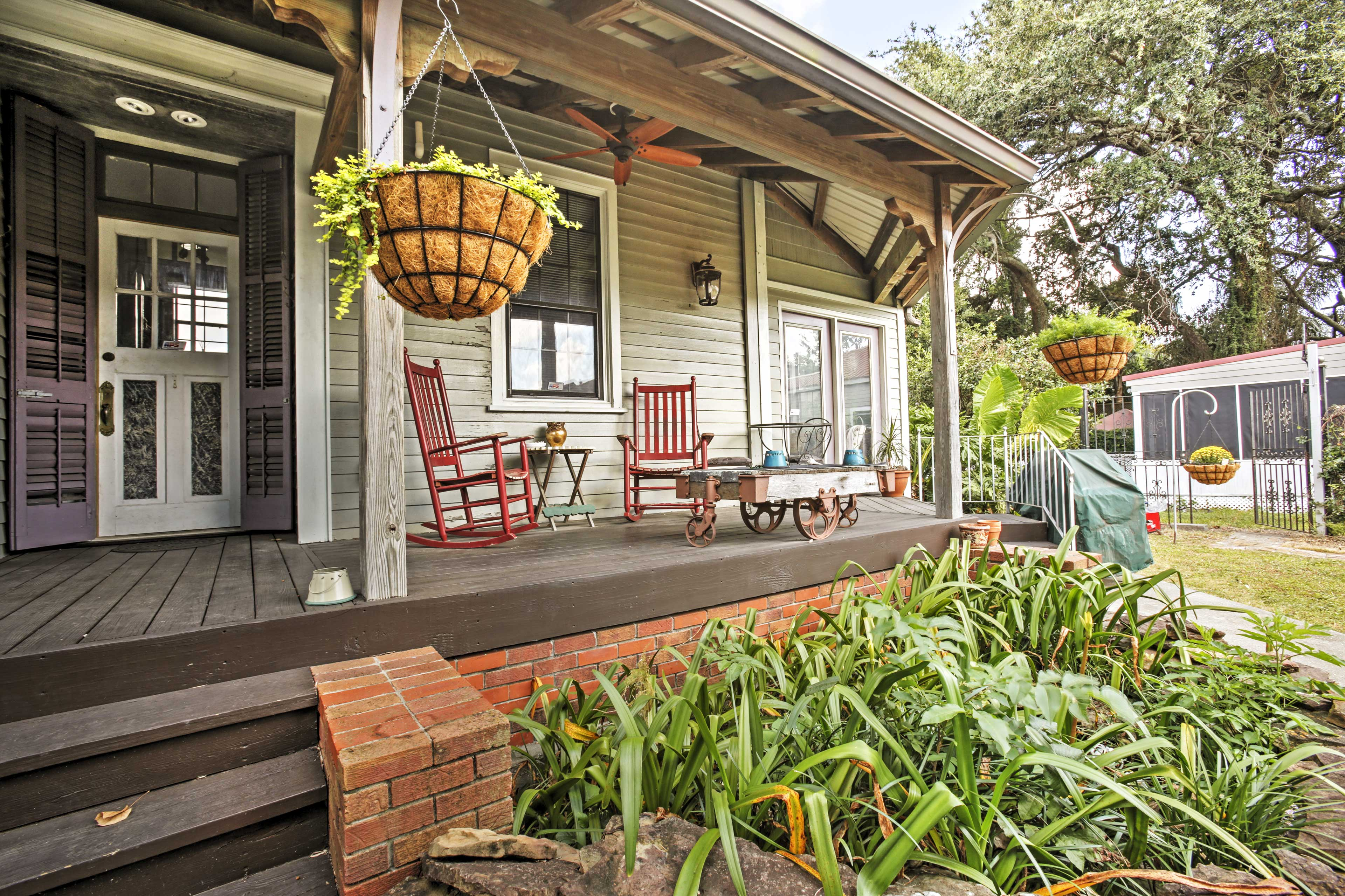 Find your NOLA state-of-mind as you relax under the shaded porch.