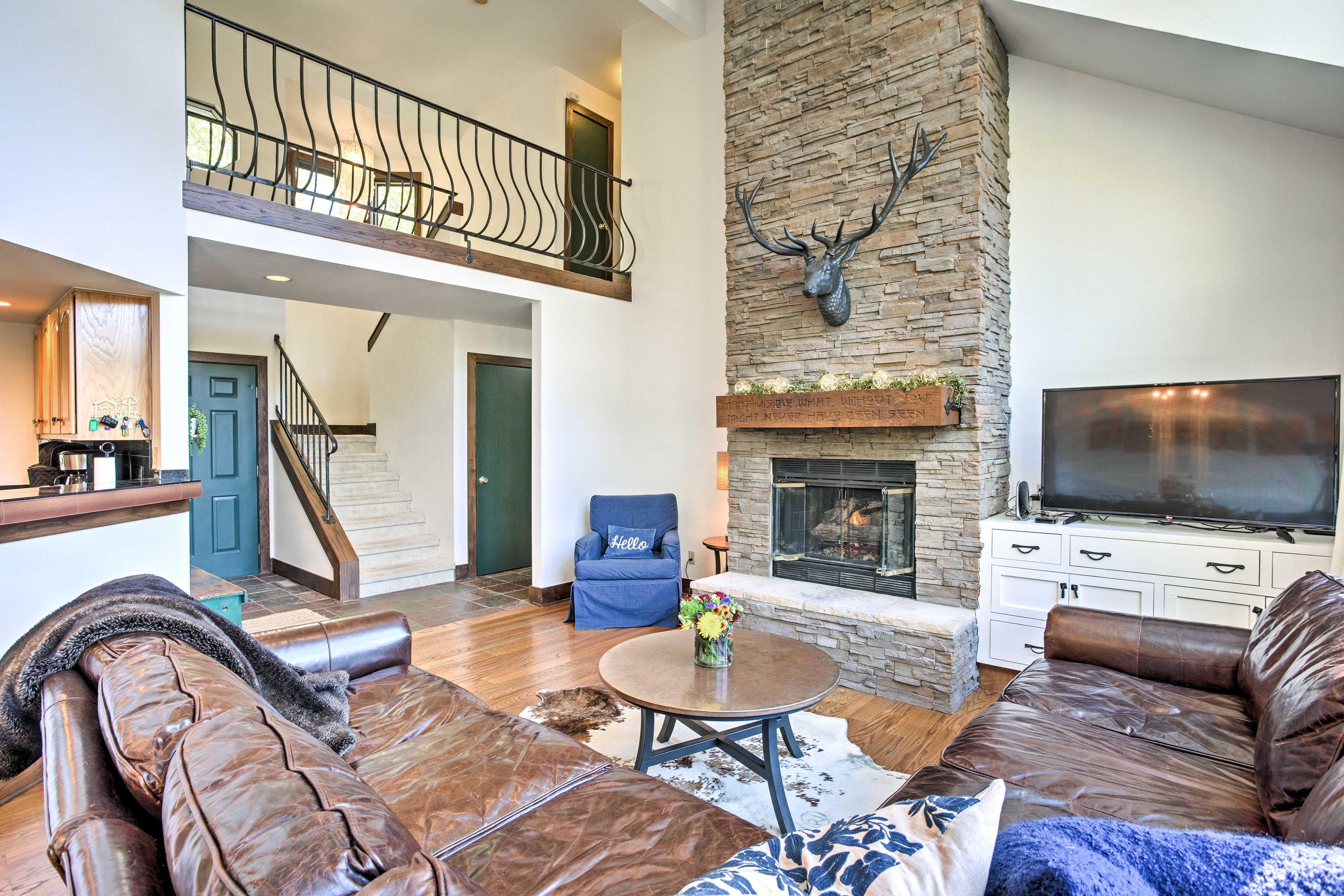 Curl up on the large sectional and cozy up by the stone fireplace in the living area.