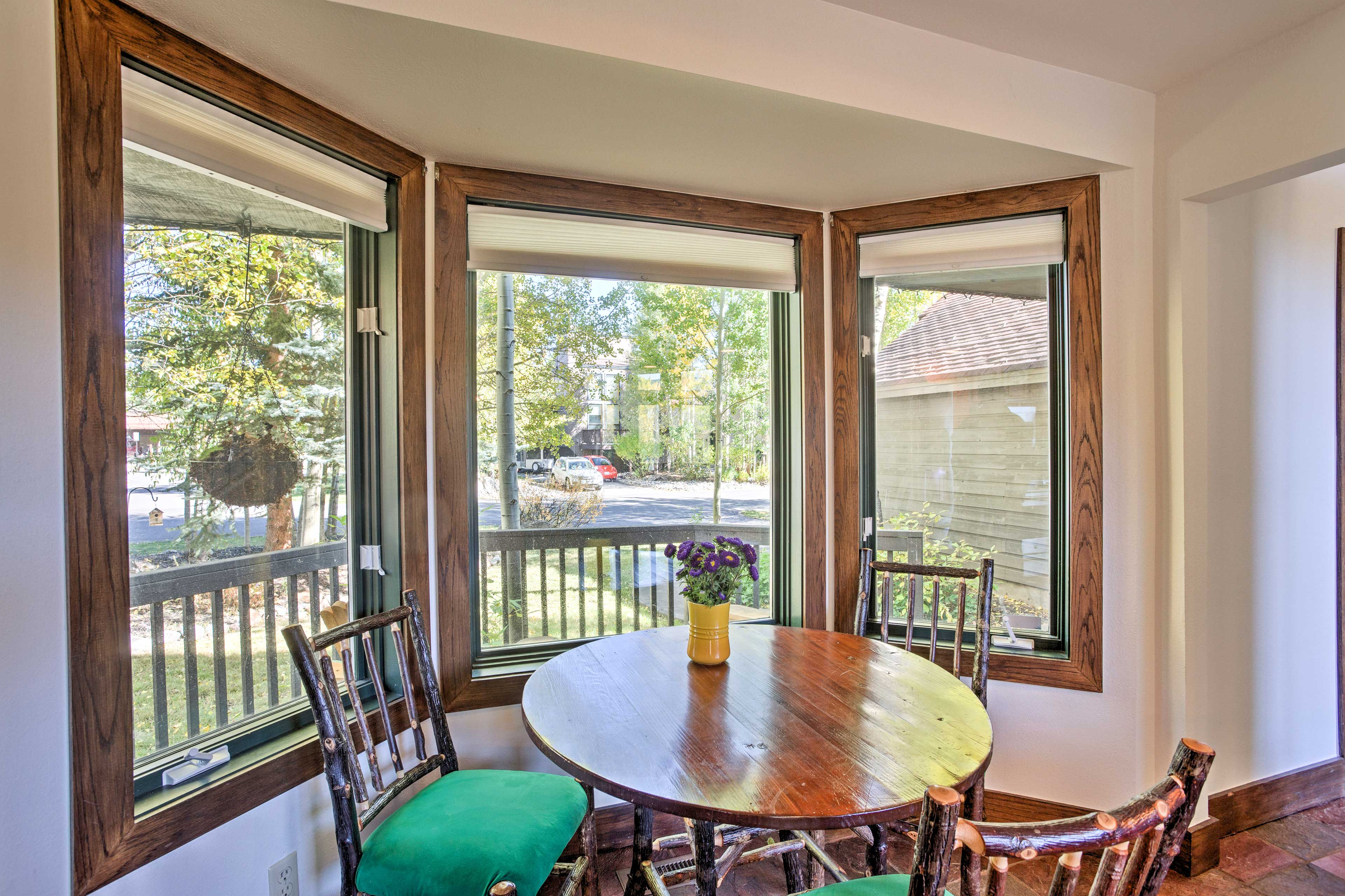 Gather around this charming dining nook to enjoy tasty meals.