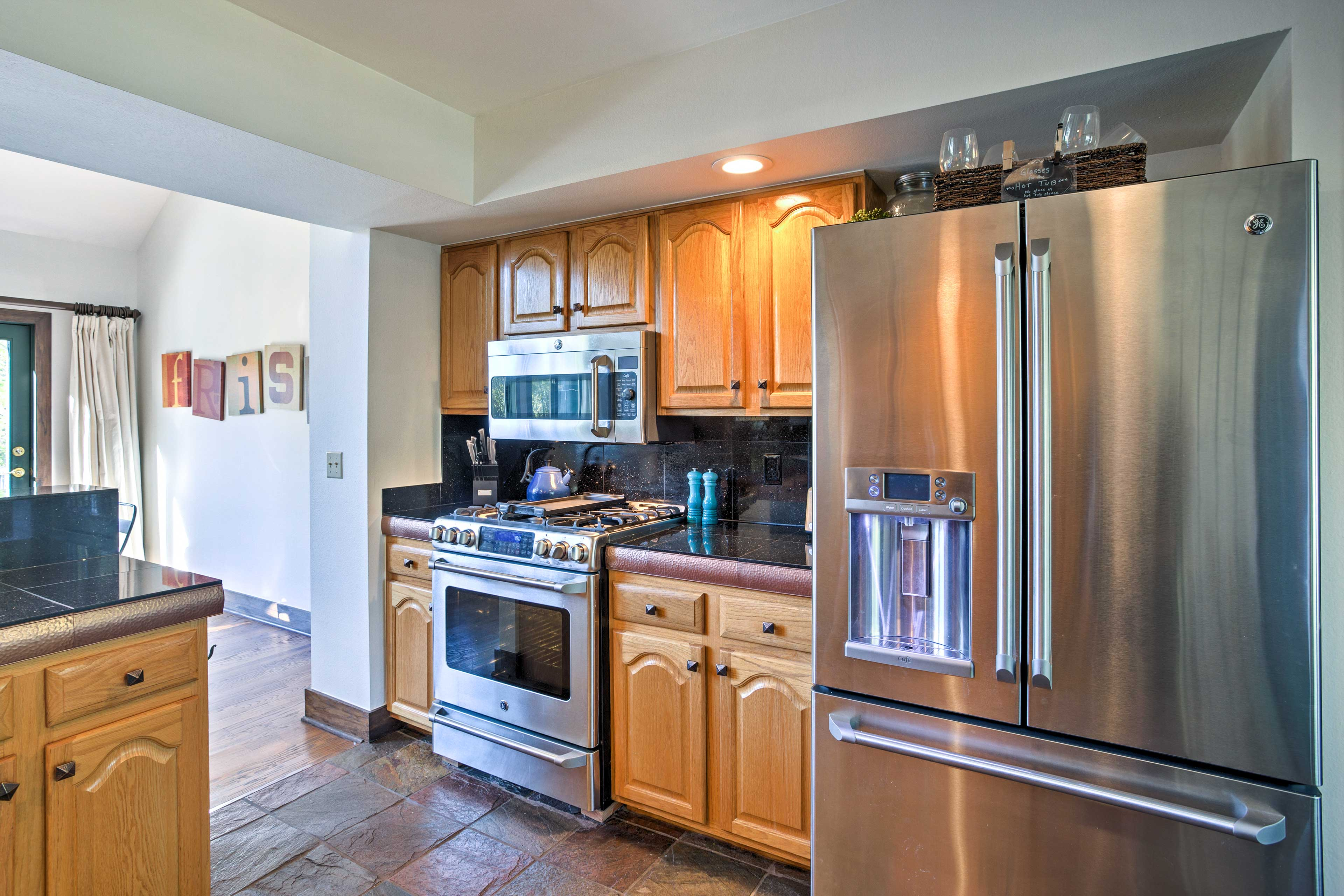 Prepare delectable meals in the fully equipped kitchen with stainless steel appliances.