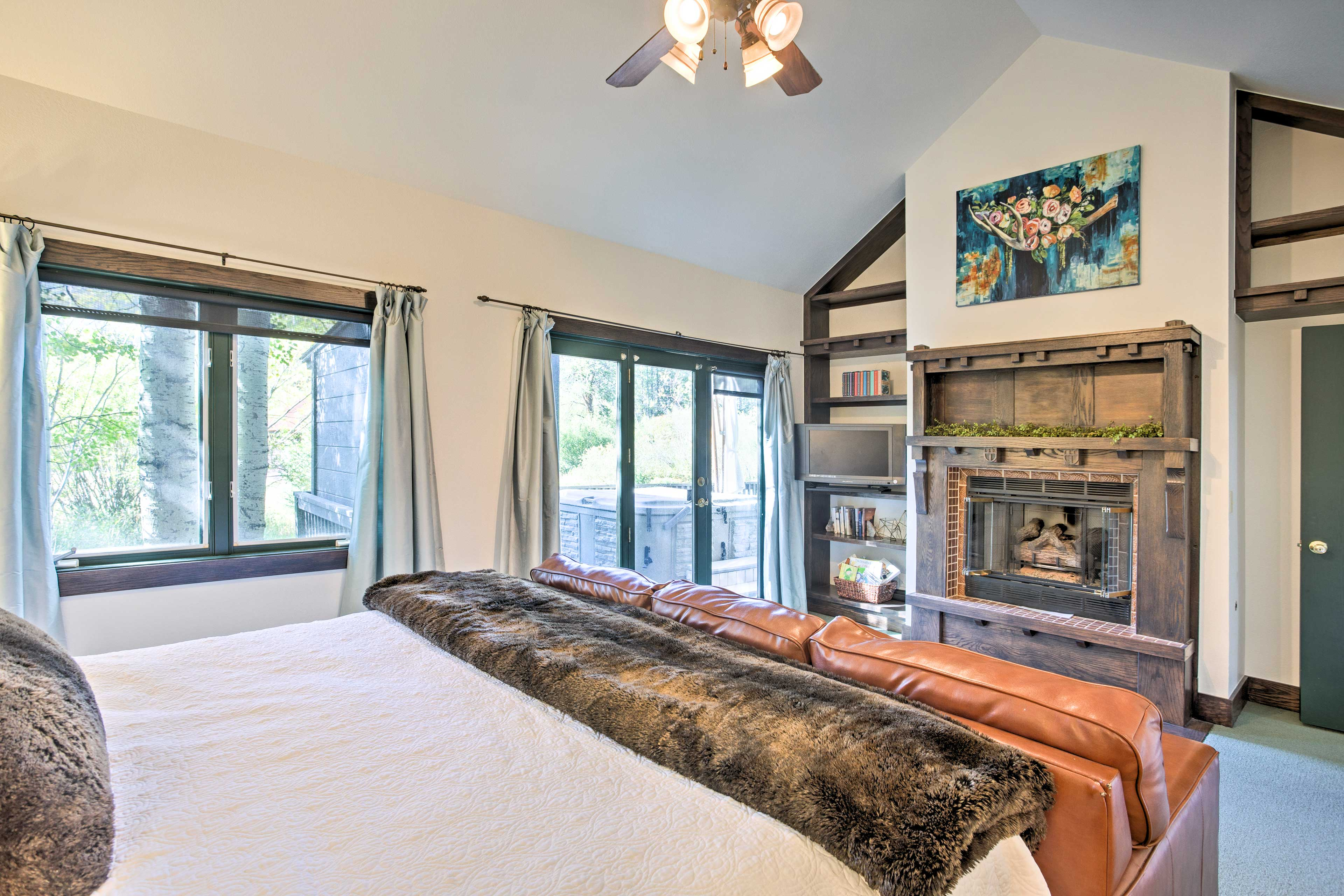 The master suite also boasts a rustic fireplace and cable TV.