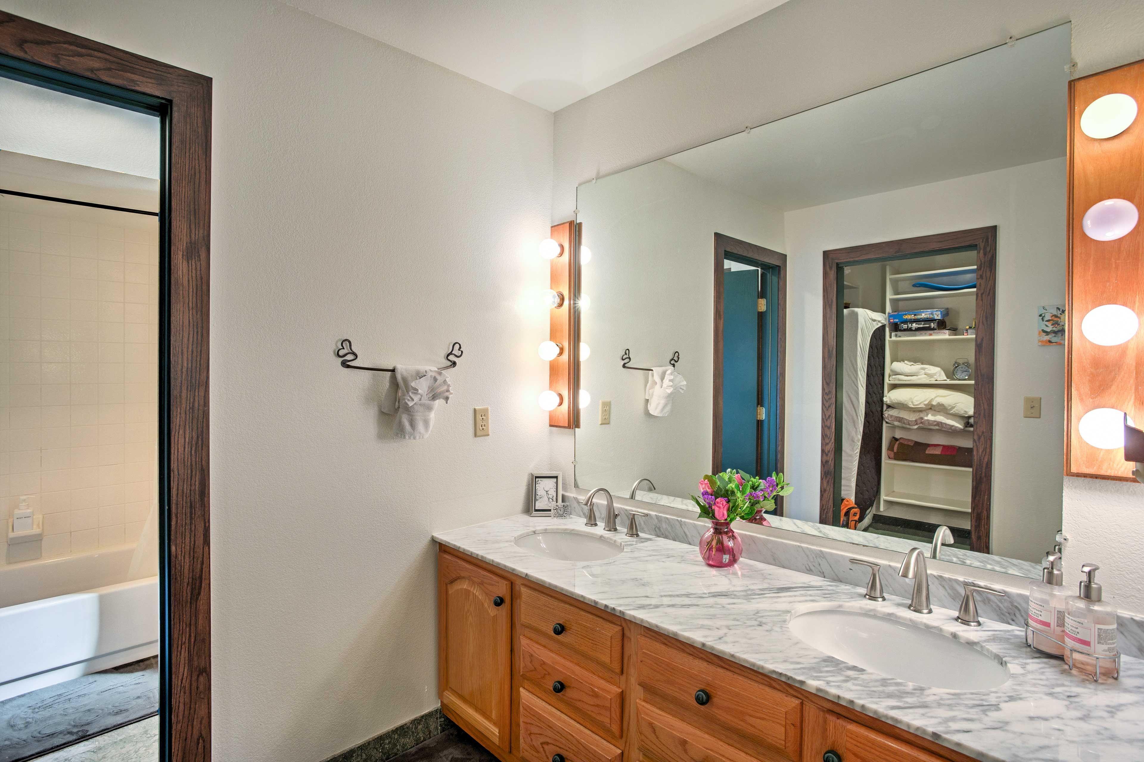 Freshen up in the master bathroom with double-sink vanity and walk-in shower.