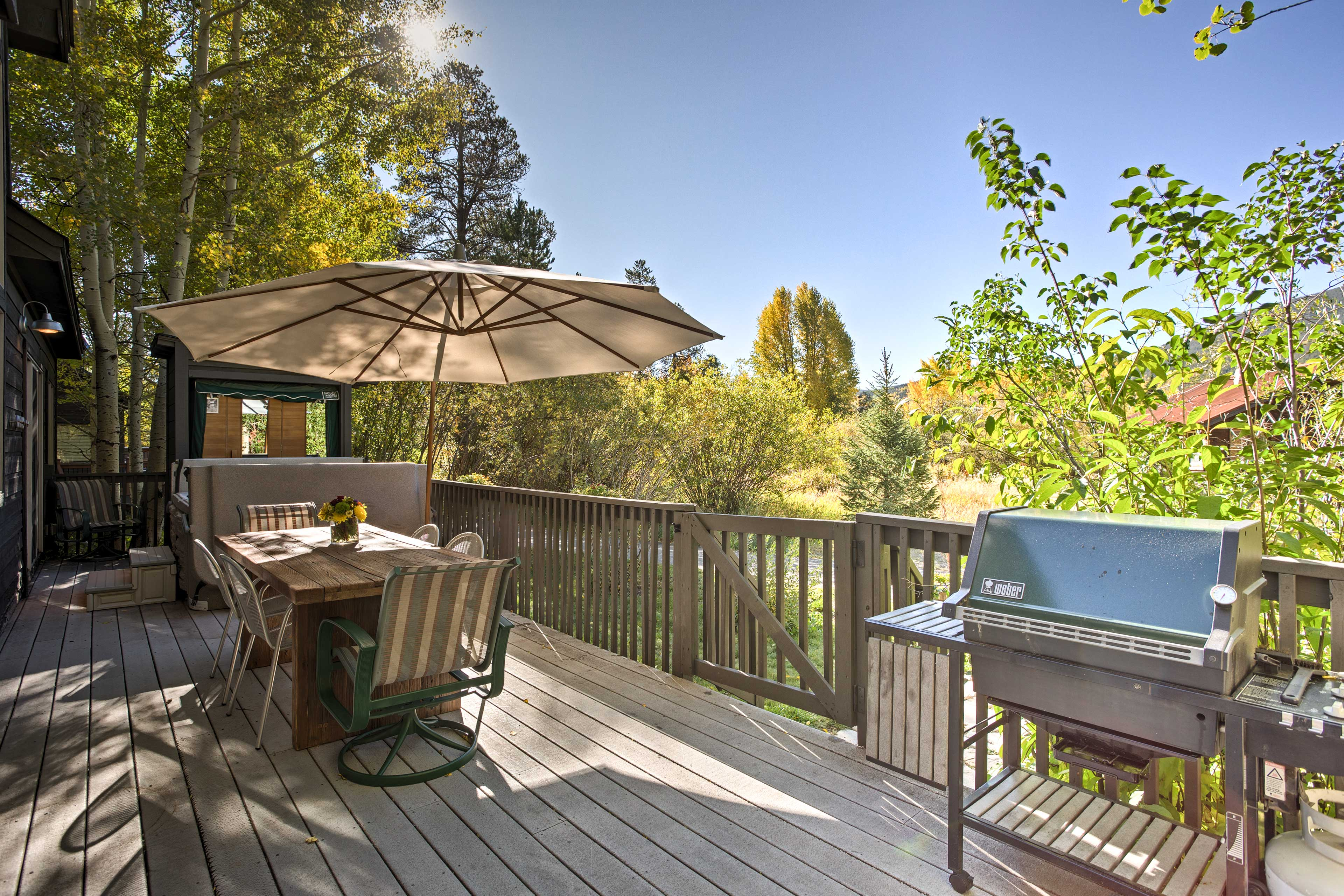 Soak up the sun and take in the mountain views from the deck.