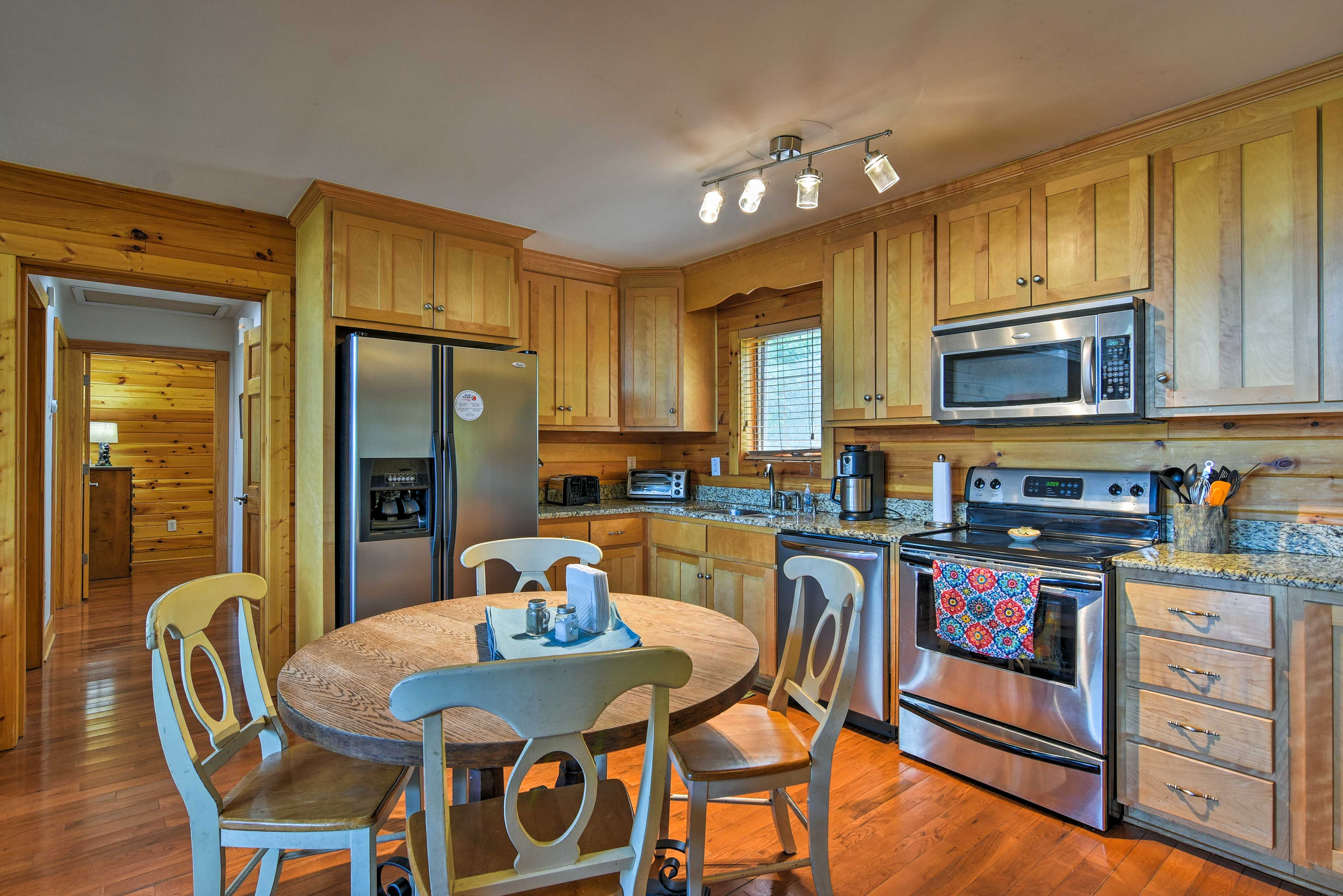 The kitchen provides additional seating at the 4-person table and breakfast bar.